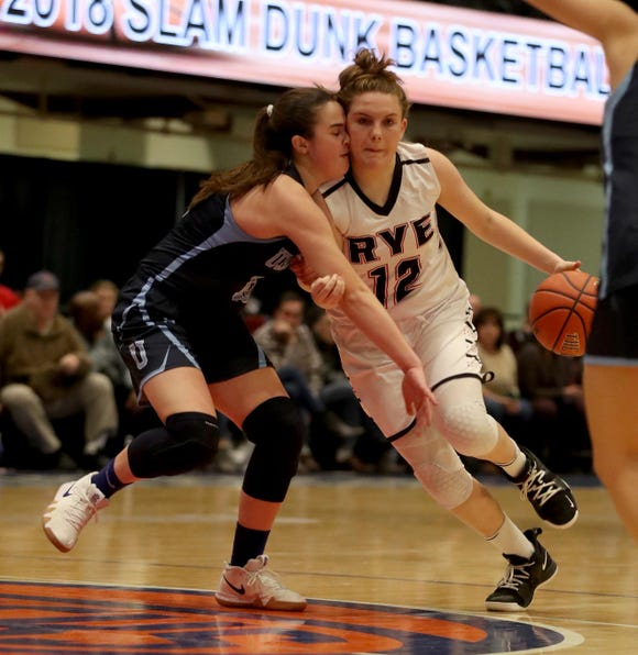 Teaghan Flaherty of Rye collides with Jane McCauley of Ursuline as she drives to the basket during a Slam Dunk Tournament basketball game at the Westchester County Center Dec. 19, 2018. Ursuline defeated Rye 72-42.