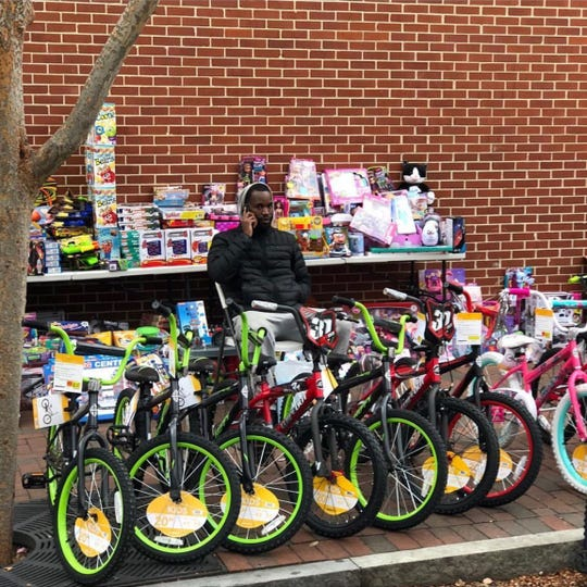 LaDaye 'Cooley' Johnson with toys from the 2017 Cool Shoes Inc. Toy Drive