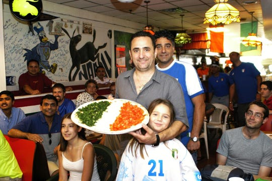 In 2006, members of the Dellamonica family, who own Margherita's Pizza in Newark, show their support for the Italian soccer team with a pizza made to look like the Italian flag. The pizzeria is closing Dec. 23 and moving to a new location in spring 2019.