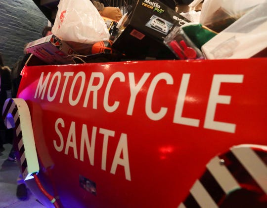 A sleigh is filled to the brim with gifts at this year's Motorcycle Santa toy drive at Trolley Square Oyster House.