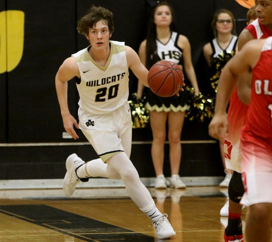 Archer City's Kolbi Cox dribbles in the game against Olney Tuesday, Dec. 18, 2018, in Archer City. The Wildcats defeated the Cubs 59-44.