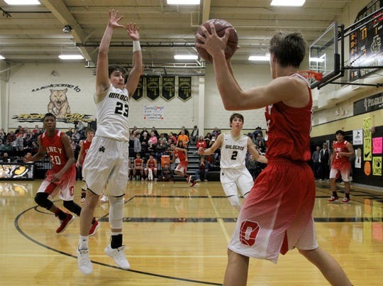 Olney's Parker Mayers passes in the game against Archer City Tuesday, Dec. 18, 2018, in Archer City. The Wildcats defeated the Cubs 59-44.
