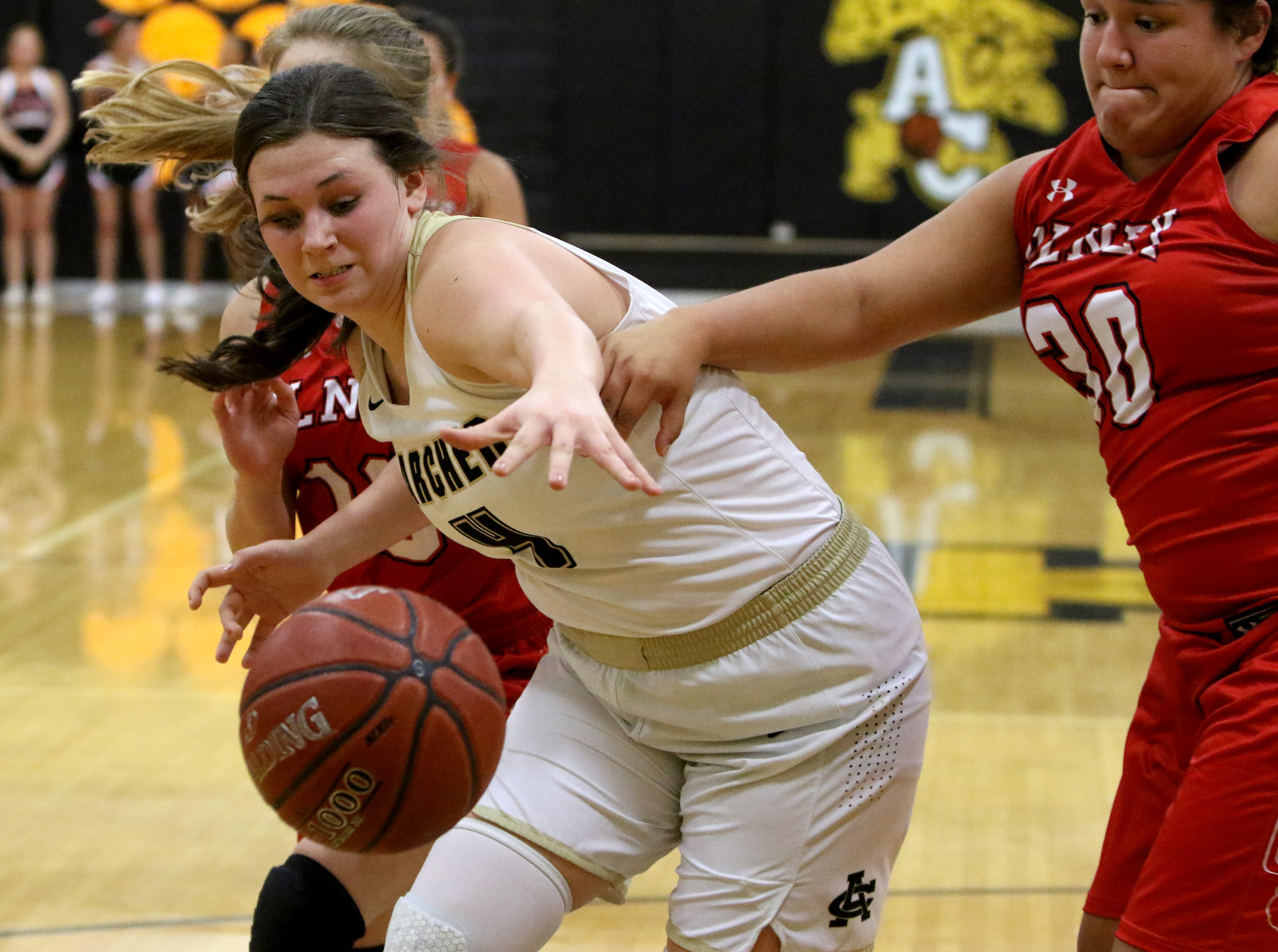Archer City's Shaylee Watson reaches for the ball as it goes out of bounds in the game against Olney Tuesday, Dec. 18, 2018, in Archer City. The Lady Cubs defeated The Lady Cats 48-43.