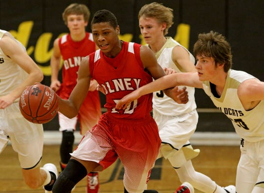Olney's Jalen Terry dribbles by Archer City's Kolbi Cox Tuesday, Dec. 18, 2018, in Archer City. The Wildcats defeated the Cubs 59-44.