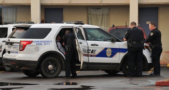 Wichita Falls police detain a possible suspect after being called to an alleged hostage situation at a motel located in the 1200 block of Broad Street early Wednesday morning.