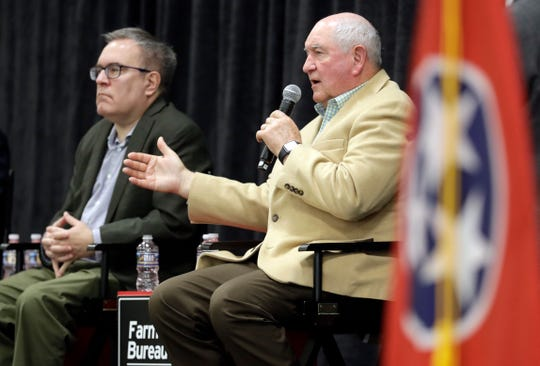 "Agriculture Secretary Sonny Perdue, right, and Acting EPA administrator Andrew Wheeler answer questions Tuesday, Dec. 18, 2018, in Lebanon, Tenn. The two met with farmers about a new Trump administration proposal to redefine ""waters of the United States."""