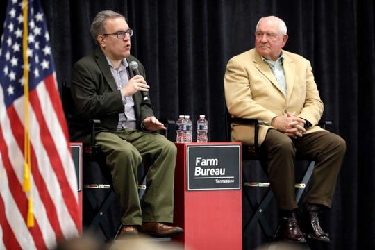 "Acting EPA administrator Andrew Wheeler, left, and Agriculture Secretary Sonny Perdue answer questions Tuesday, Dec. 18, 2018, in Lebanon, Tenn. The two met with farmers about a new Trump administration proposal to redefine ""waters of the United States."""