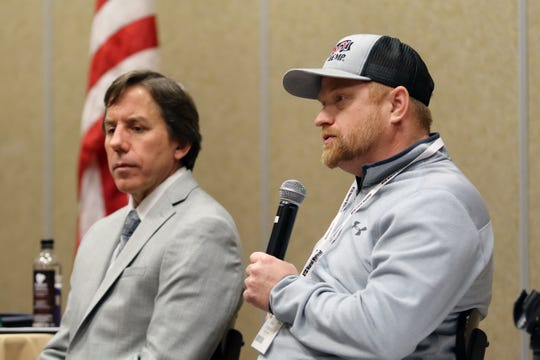 Ken Anderson (right), founder and President of Legacy Hemp Holdings, talks about hemp production with producers at the Wisconsin Farml Bureau Federation hemp workshop on Dec. 2. Also pictured is Kurt Mansavage, with Rural Mutual Insurance.