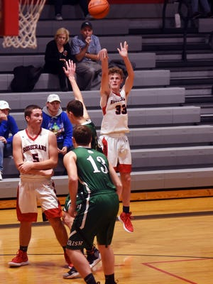 Kaid Brown fires a 3-pointer during the second quarter of Rosecrans' 70-59 win against visiting Lancaster Fisher Catholic on Tuesday night at Rogge Gymnasium. Brown scored a team-high 17 points.