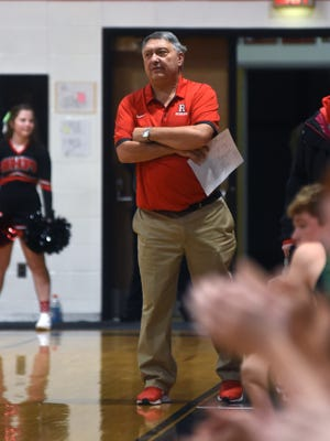 Roscrans coach Todd Rock watches intently as his team takes on Fisher Catholic earlier this season at Rogge Gymnasium. The Bishops gave the long-time coach a victory in his 600th game on the bench against Delaware Christian on Thursday.