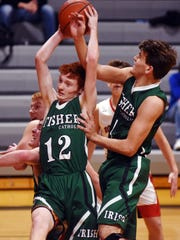 Fisher Catholic's Jayden Boyden, left, and Payton Shockley go up for a rebound during the second half against Rosecrans on Tuesday at Rogge Gymnasium in Zanesville.