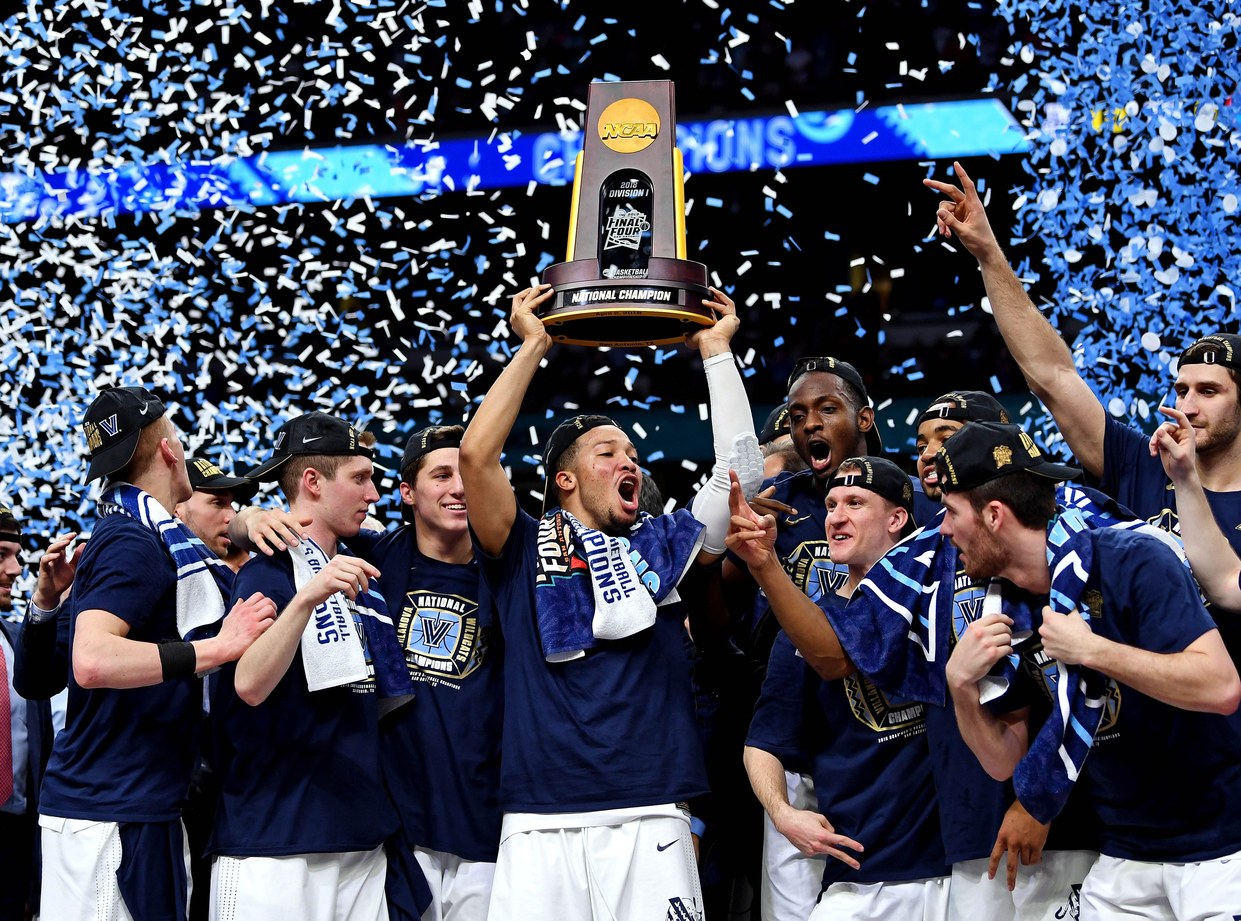 April 2, 2018: Villanova Wildcats guard Jalen Brunson celebrates with the National Championship trophy after beating the Michigan Wolverines in the championship game of the 2018 men's Final Four at the Alamodome in San Antonio, Texas.