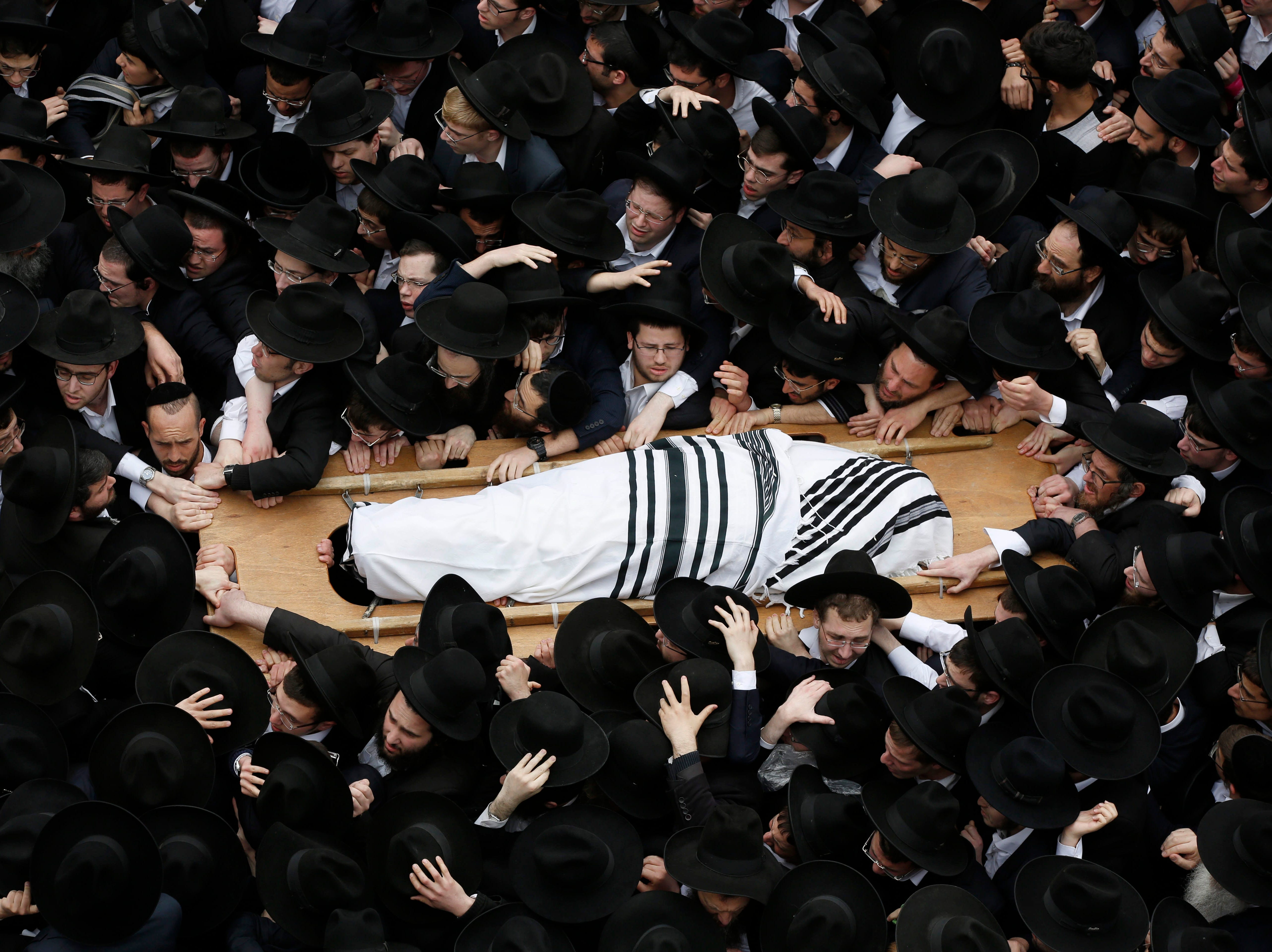Feb. 25, 2018: Ultra Orthodox Jews gather around the body of late Rabbi Shmuel Auerbach, during his funeral ceremony in Jerusalem. Rabbi Shmuel Auerbach was the spiritual leader of the non-Hasidic Lithuanian believers, he died at the age of 86.