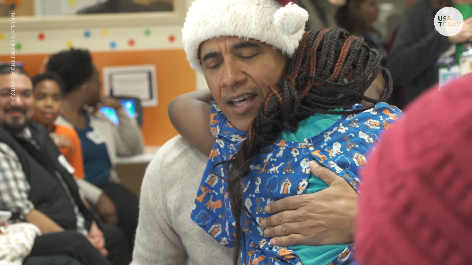 In his Santa hat, Obama surprises kids at children's hospital with toys before Christmas
