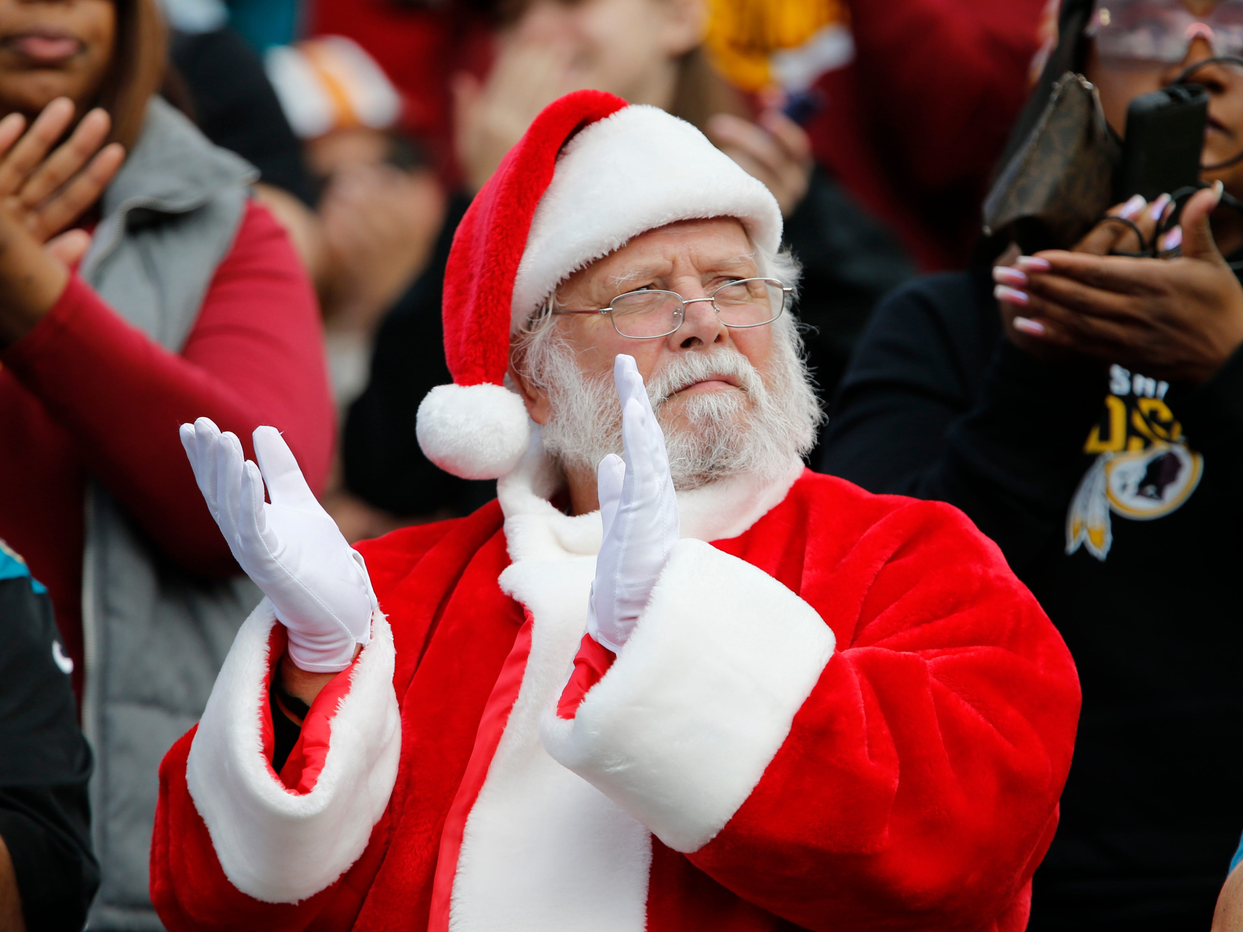 A fan dressed as Santa Claus reacts during the first quarter between the Jacksonville Jaguars and the Washington Redskins at TIAA Bank Field in Jacksonville, Fla. on Dec. 16, 2018.