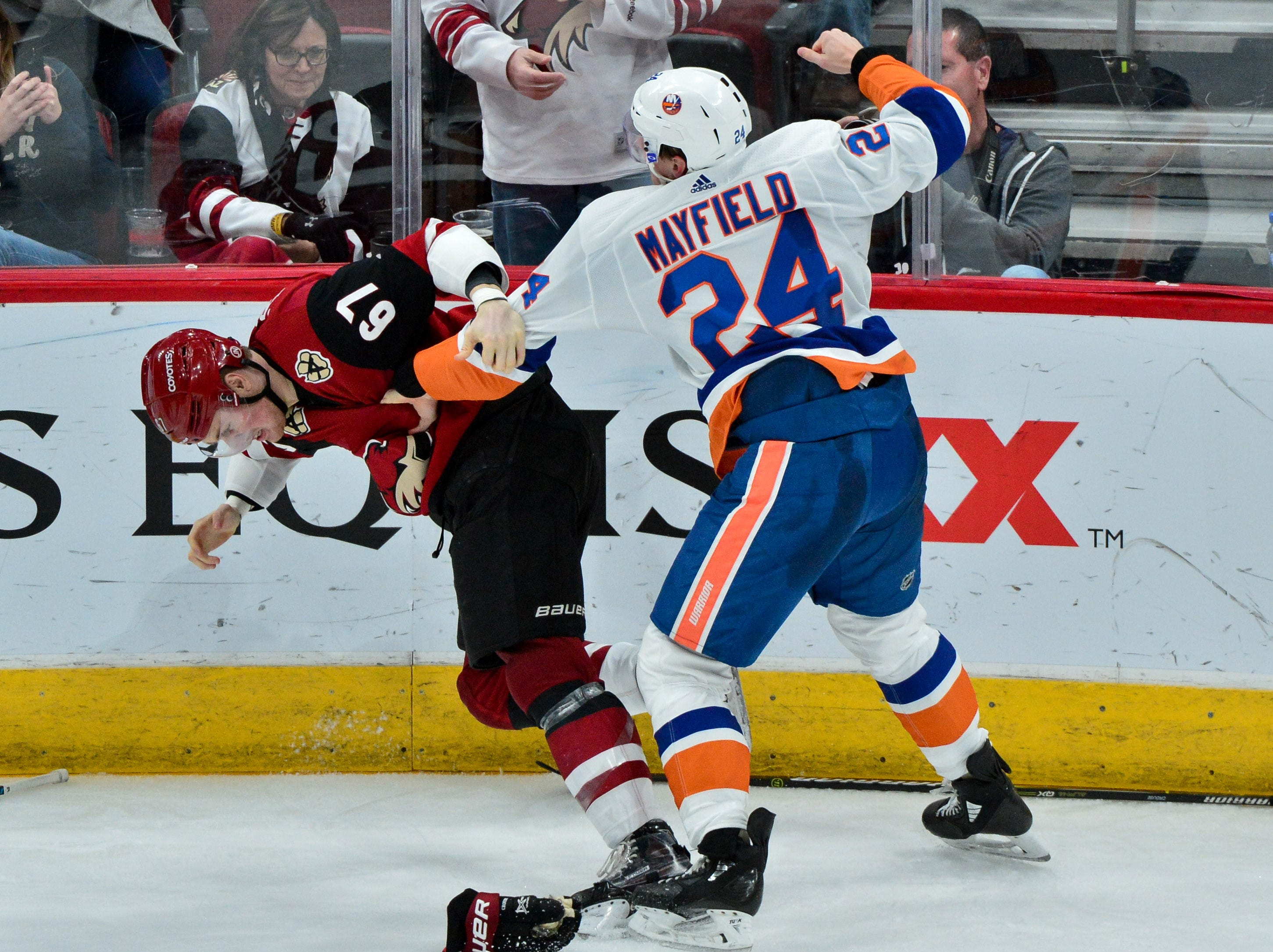 Dec. 18: Arizona Coyotes' Lawson Crouse vs. New York Islanders' Scott Mayfield.