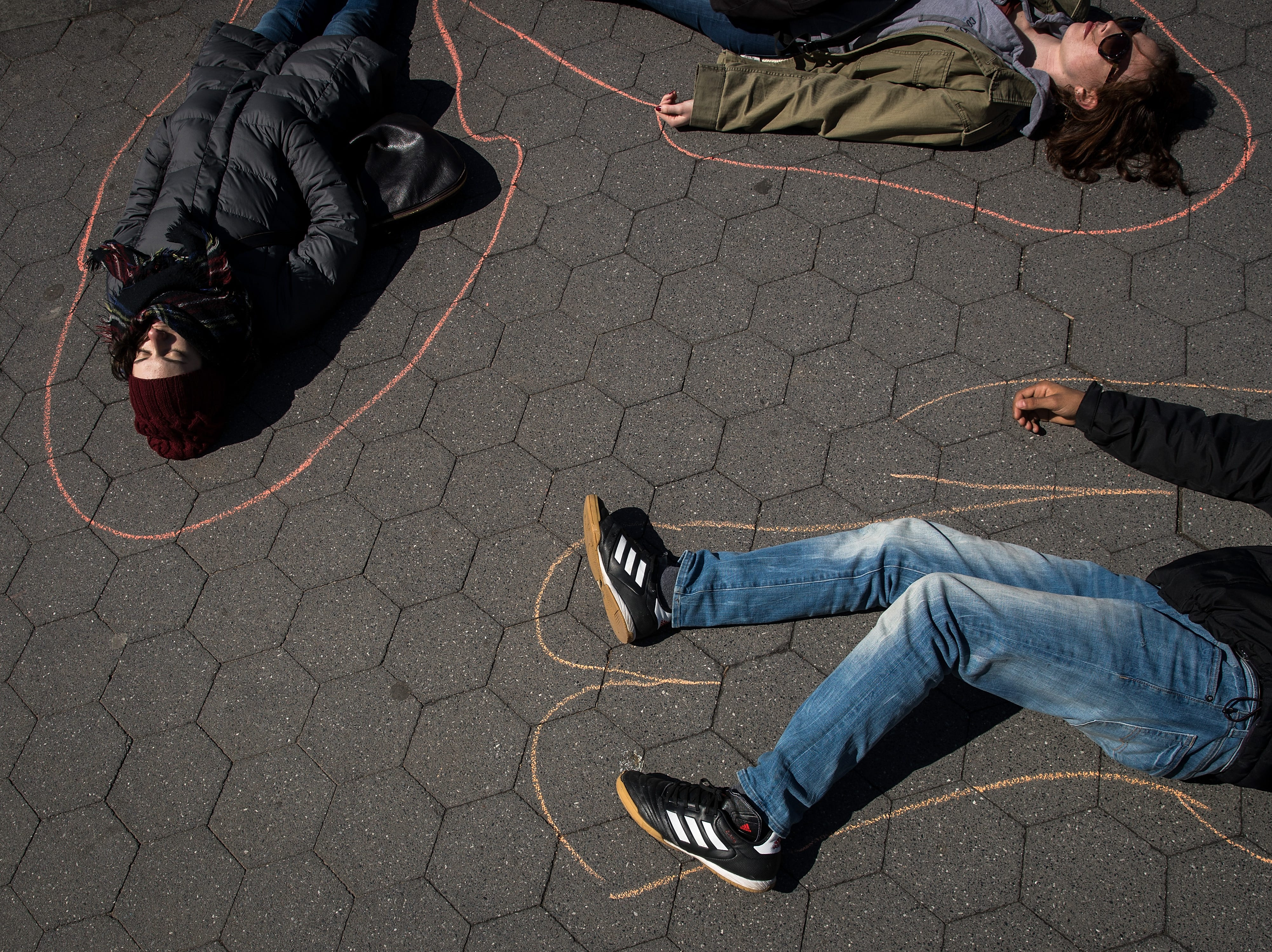 April 20, 2018: Student activists participate in a 'die-in' to protest gun violence at Washington Square Park, near the campus of New York University in New York City. On the anniversary of the 1999 Columbine High School mass shooting, student activists across the country are participating in school walkouts to demand action on gun reform.