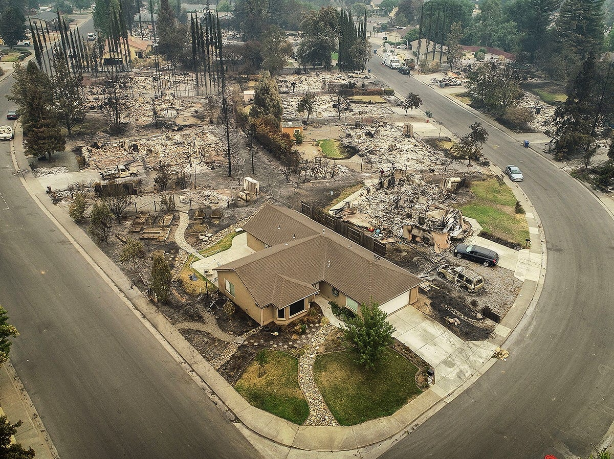 July 31, 2018: An aerial view of the homes of Harlan Drive and Bedrock Lane in the Lake Redding Estates neighborhood shows the devastation caused by the Carr Fire which roared through the area. The area remains closed to residents as crews work to restore some of the infrastructure in the area. The fire burned more than 162 square miles and destroyed more than 1,100 structures.
