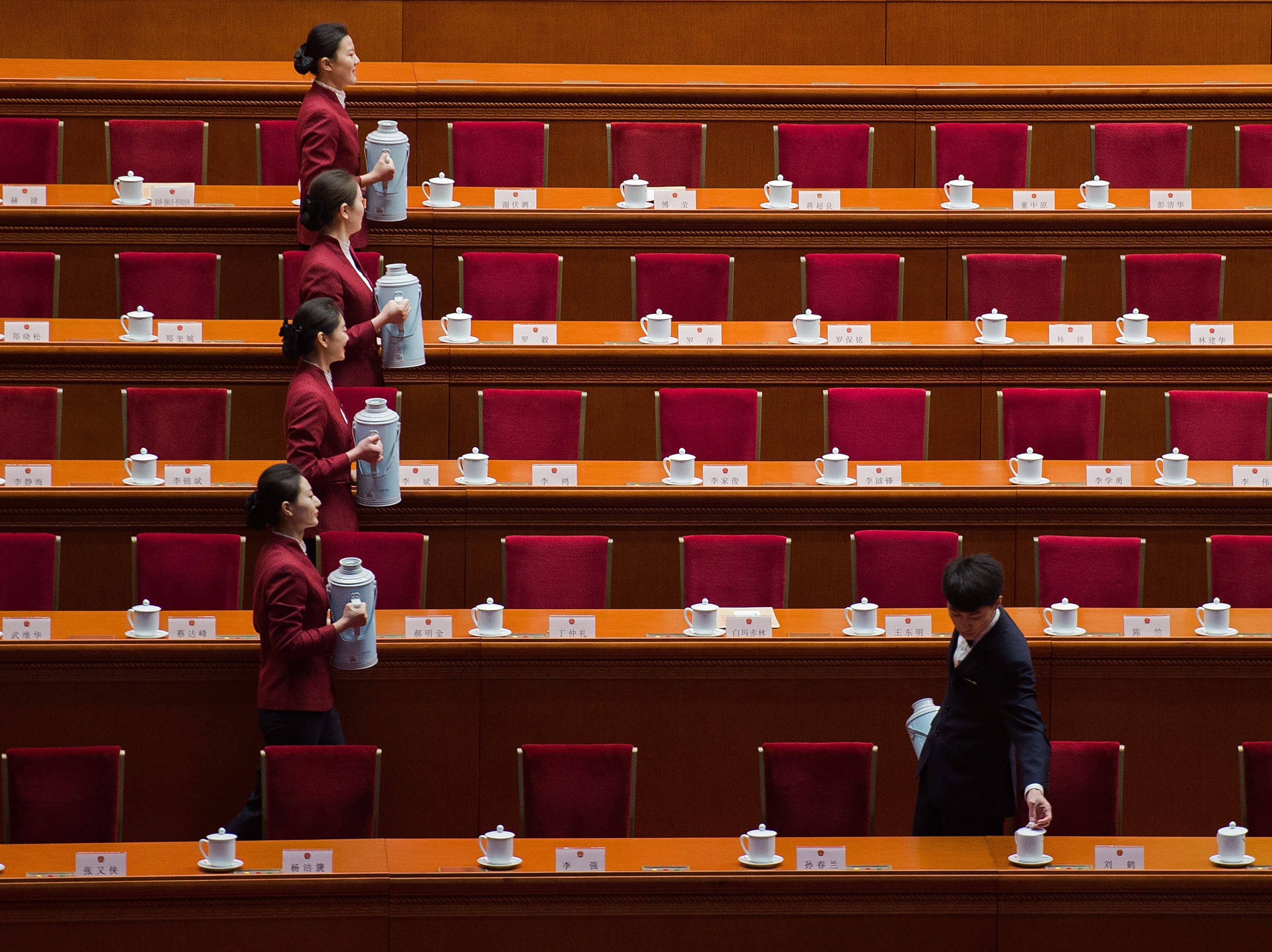 March 18, 2018: Hostesses serve tea ahead of the sixth plenary session of the National People's Congress at the Great Hall of the People in Beijing.