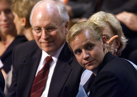 "The real Dick Cheney sits with daughter Mary Cheney at the Republican National Convention in 2000. Cheney is portrayed in ""Vice"" as a devoted father who supports his daughter's gay relationship, and also his other daughter's stance against gay marriage."