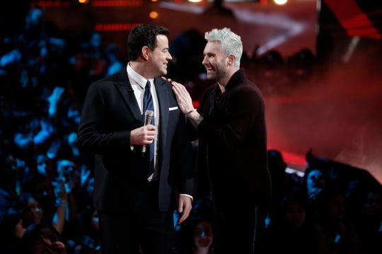 'The Voice' coach Adam Levine talks to host Carson Daly during Tuesday's Season 15 finale. Levine frequently gets up to greet performers and talk to fellow coaches during the show.