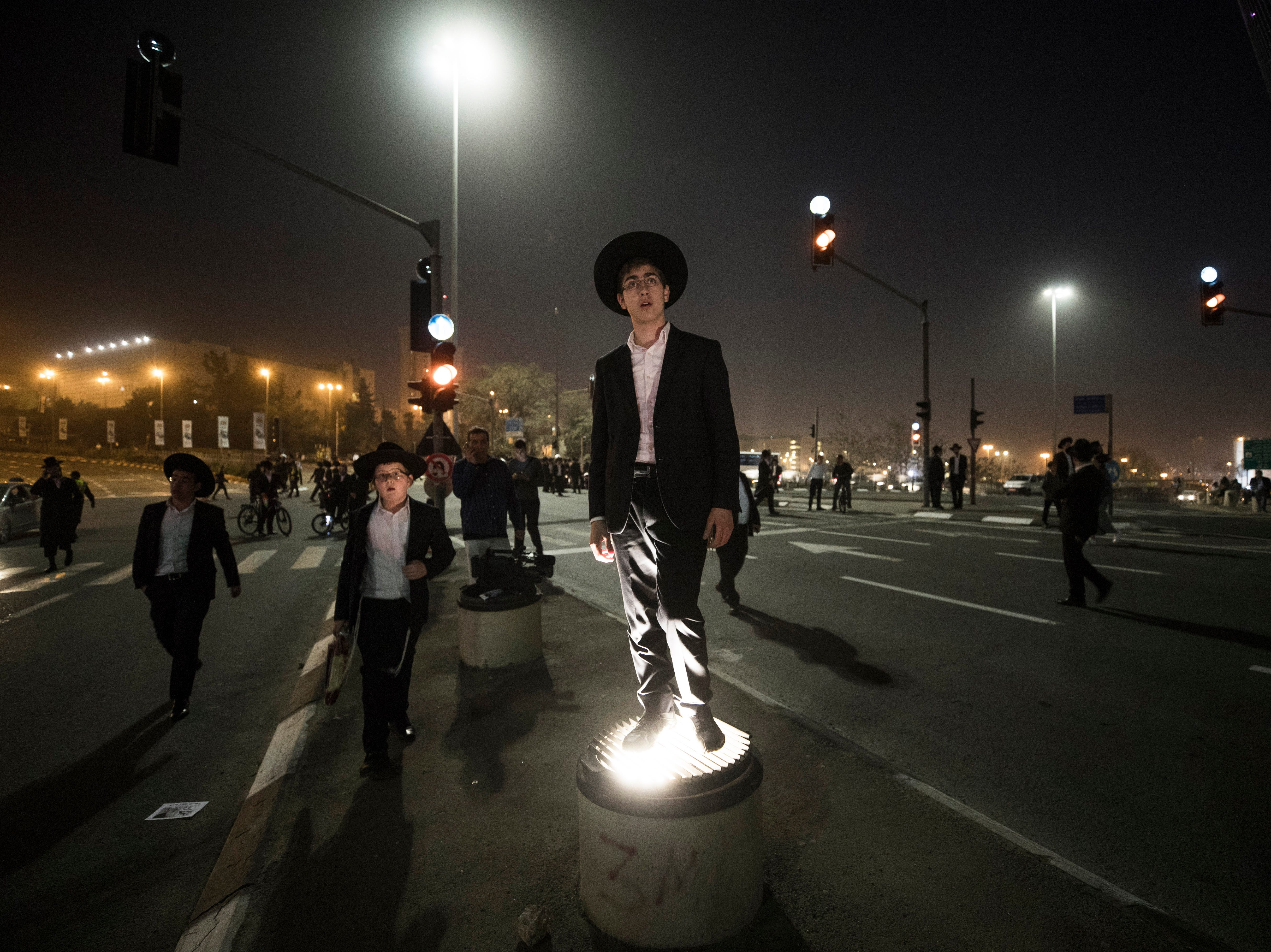 March 8, 2018: Ultra-Orthodox Jewish men block the main entrance to Jerusalem, Israel during a demonstrator against army conscription. The Ultra-Orthodox community in Israel is holding ongoing protests against army conscription.