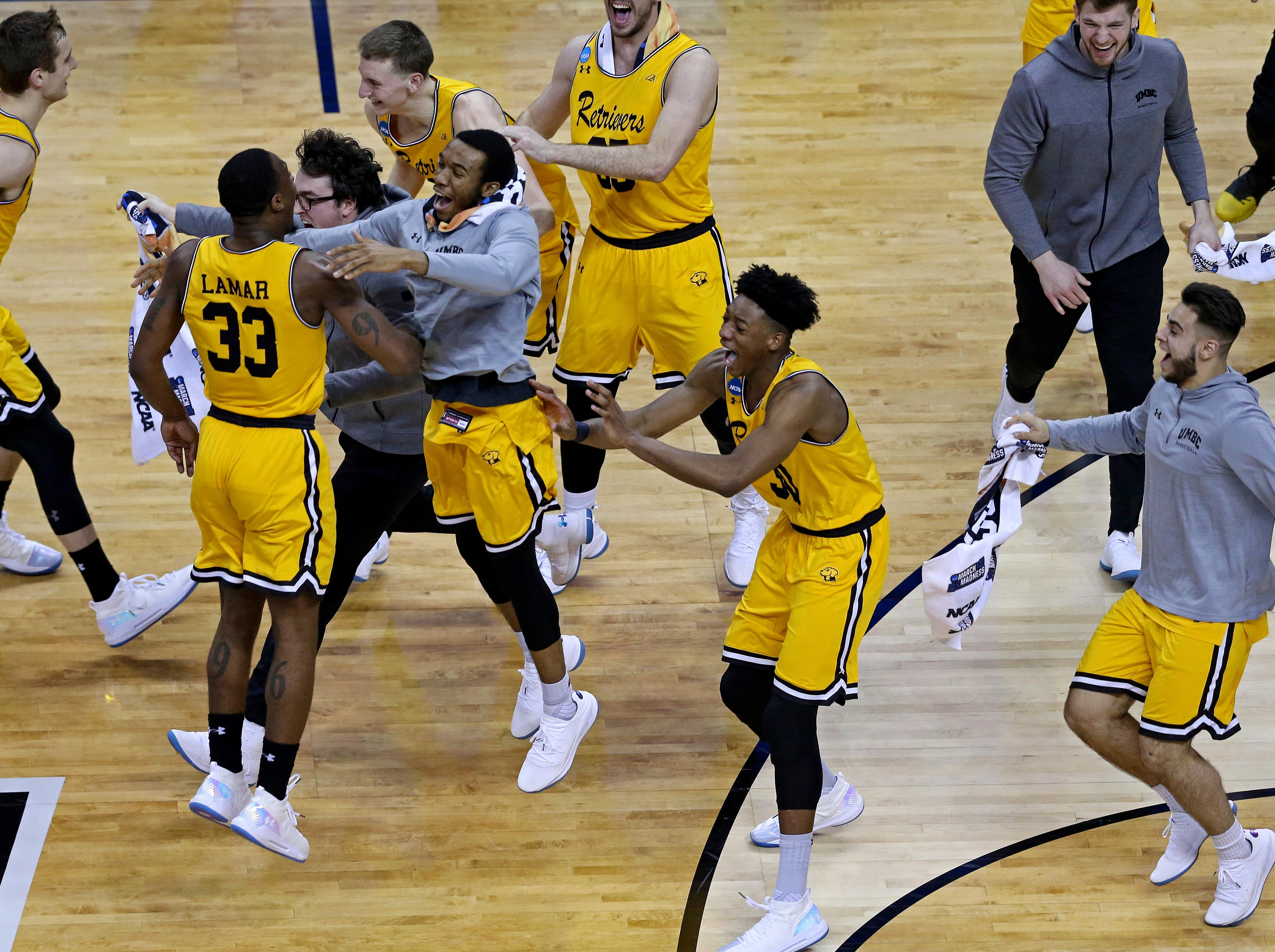 March 16, 2018: Players from the University of Maryland - Baltimore County celebrate after defeating the Virginia Cavaliers in the first round of the 2018 NCAA Tournament. In a history making stunner, No. 16 seed Maryland Baltimore County upsets No. 1 seed UVA in the first round of the NCAA tournament.