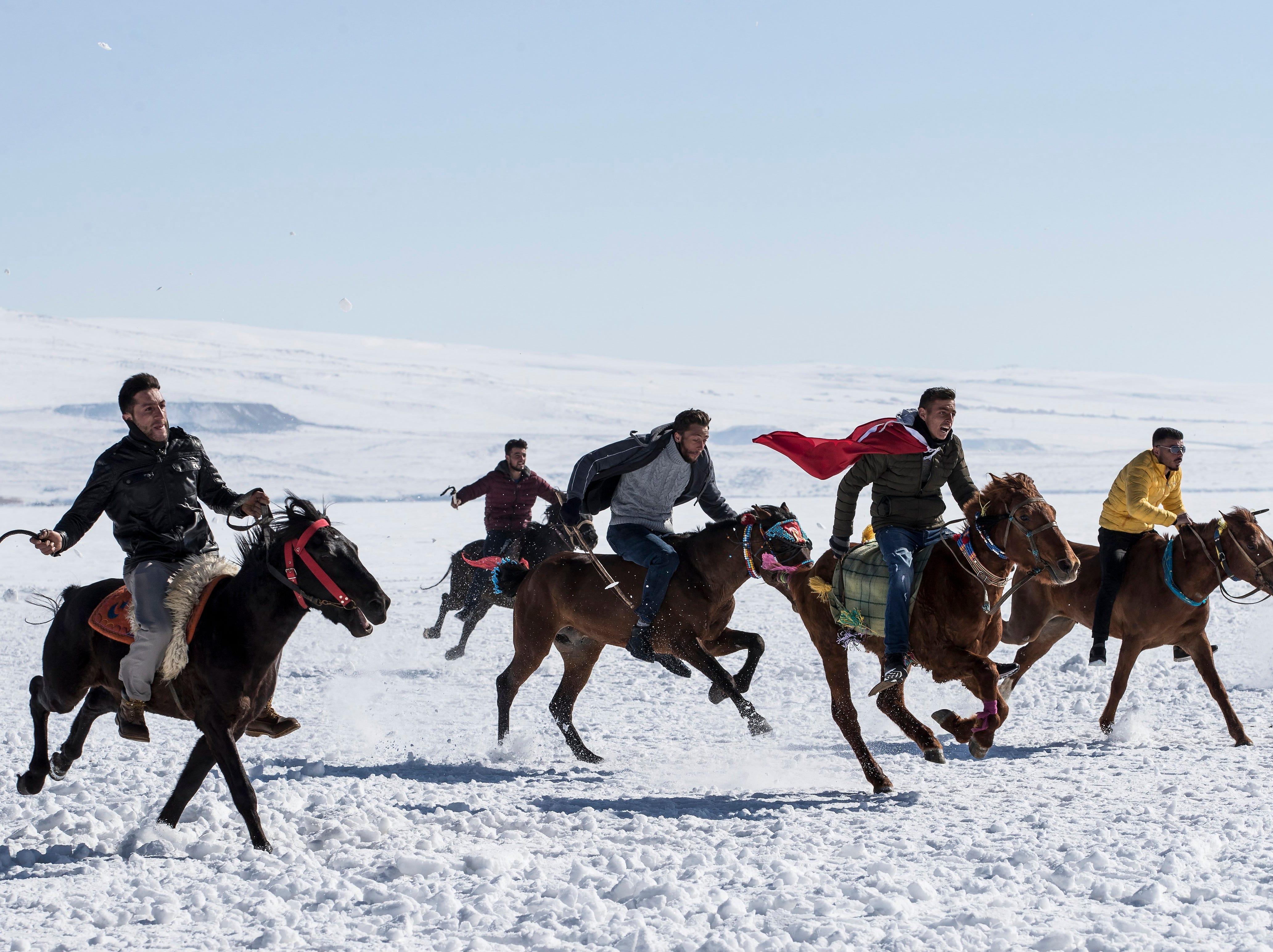 Feb. 10, 2018: Men take part in a horse race across the frozen Cildir Lake during the Cildir Lake Golden Horse Festival at Cildir Lake in Karst, Turkey.