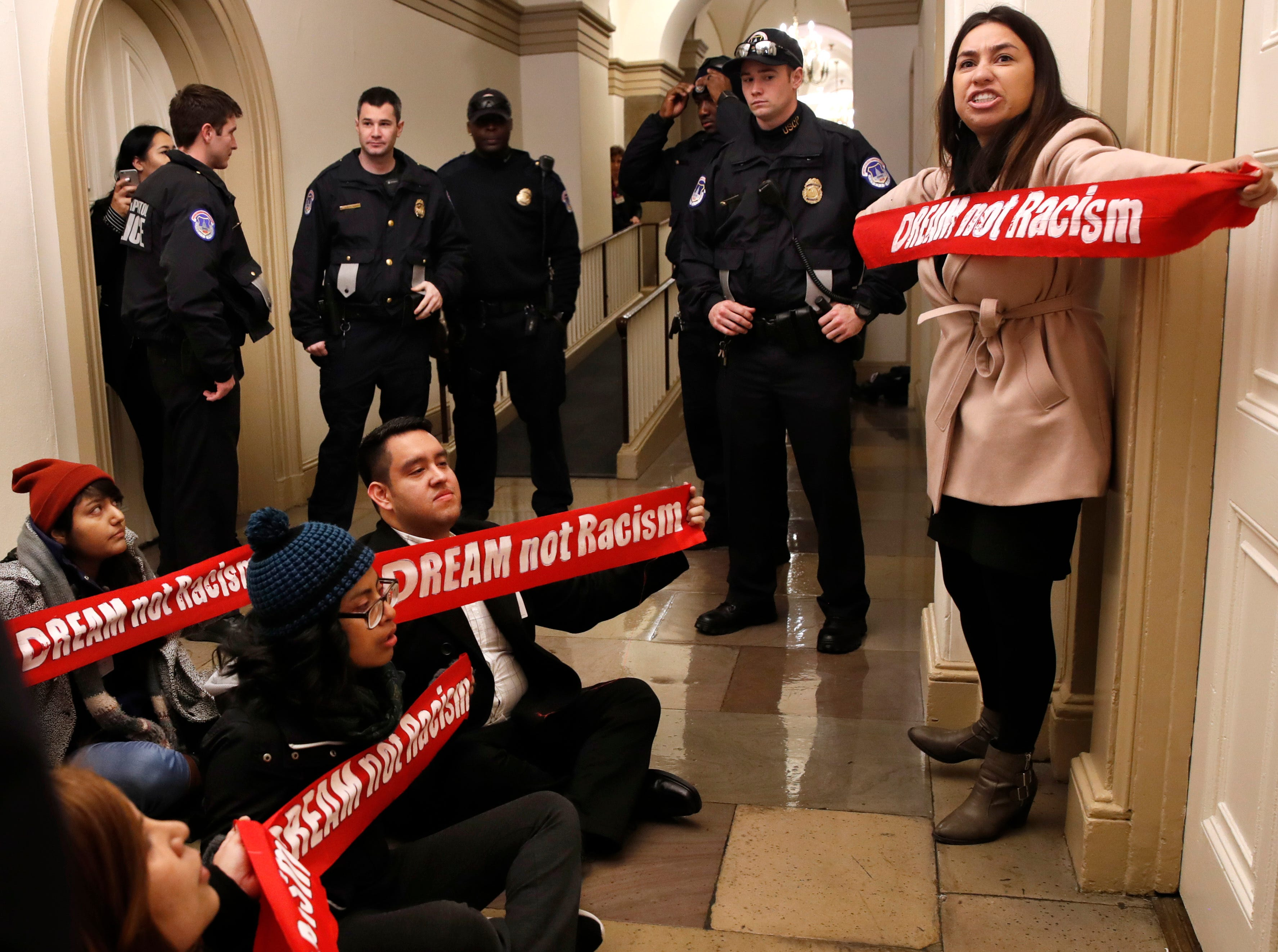 Jan. 18, 2018: Diana Colin, right, with the Coalition for Humane Immigrant Rights, shouts as the group from California protests outside the office of House Majority Leader Kevin McCarthy, of California, on Capitol Hill in Washington.