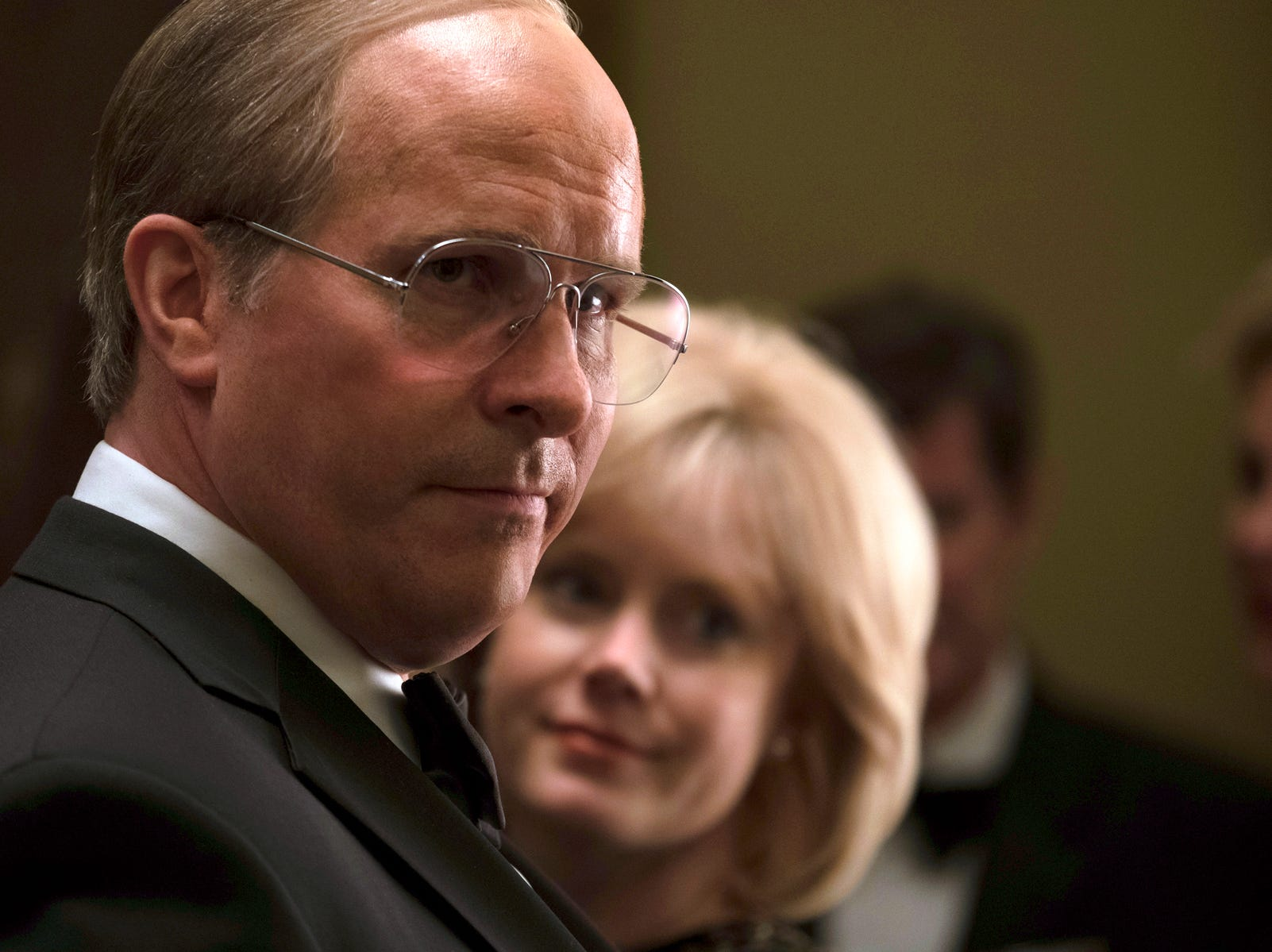 "This image released by Annapurna Pictures shows Christian Bale as Dick Cheney, left, and Amy Adams as Lynne Cheney in a scene from ""Vice.""  On Thursday, Dec. 6, 2018, Bale was nominated for a Golden Globe award for lead actor in a motion picture comedy or musical for his role in the film. The 76th Golden Globe Awards will be held on Sunday, Jan. 6. (Matt Kennedy/Annapurna Pictures via AP) ORG XMIT: NYET827"