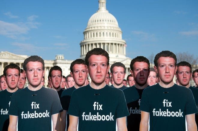 April 10, 2018: One hundred cardboard cutouts of Facebook founder and CEO Mark Zuckerberg stand outside the US Capitol in Washington, DC. Advocacy group Avaaz is calling attention to what the groups says are hundreds of millions of fake accounts still spreading disinformation on Facebook.