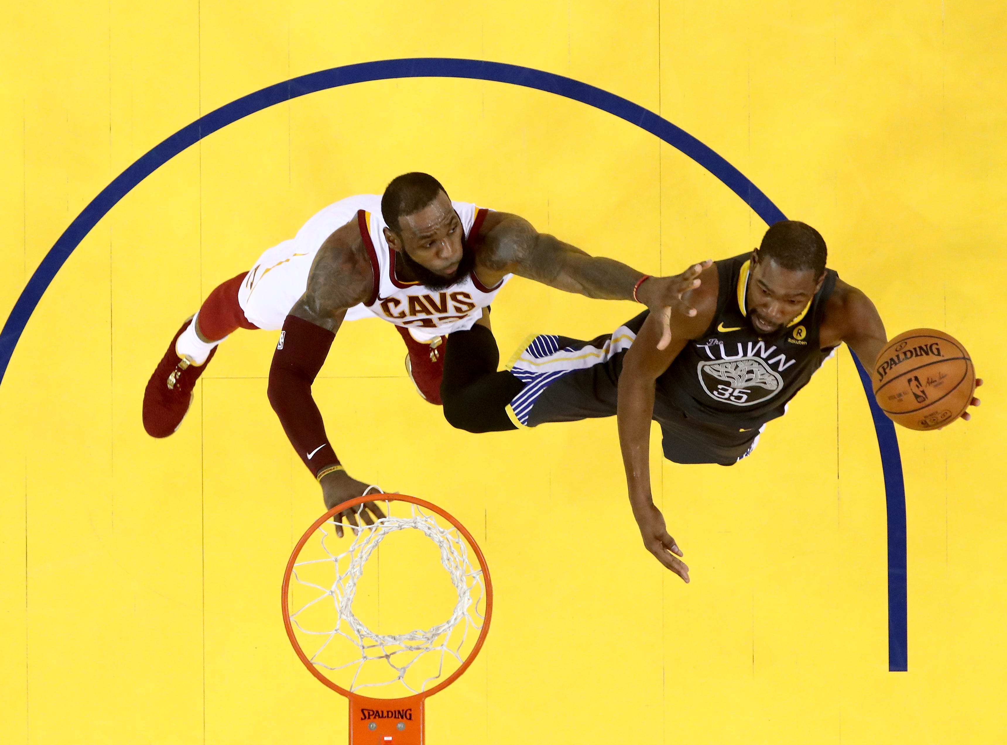 June 3, 2018: Kevin Durant of the Golden State Warriors attempts a layup against LeBron James of the Cleveland Cavaliers in Game 2 of the 2018 NBA Finals in Oakland, Calif