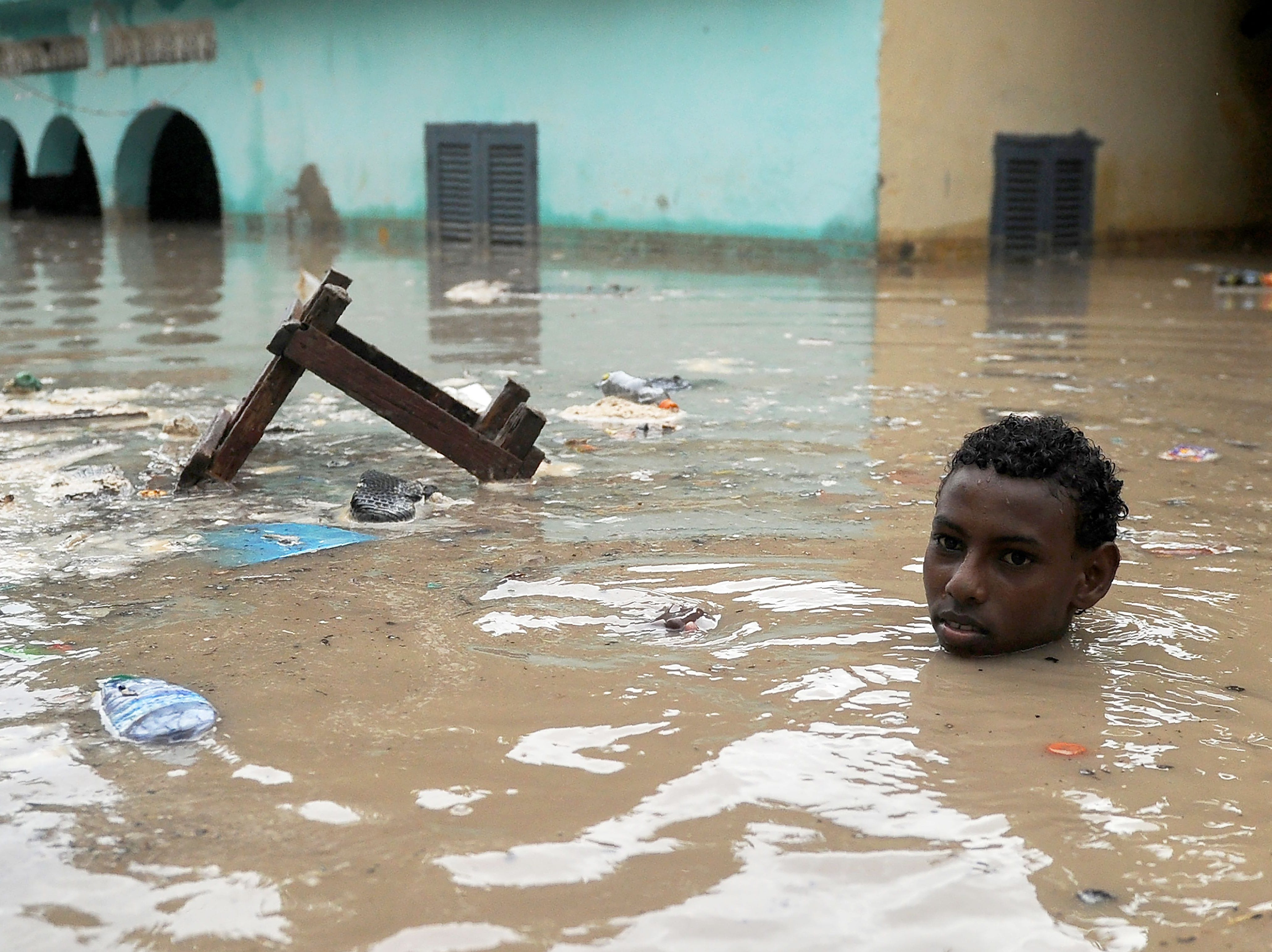 May 20, 2018: A young man wades through neck-deep flood water in Mogadishu after homes were inundated in Somalia's capital following heavy overnight rainfall.