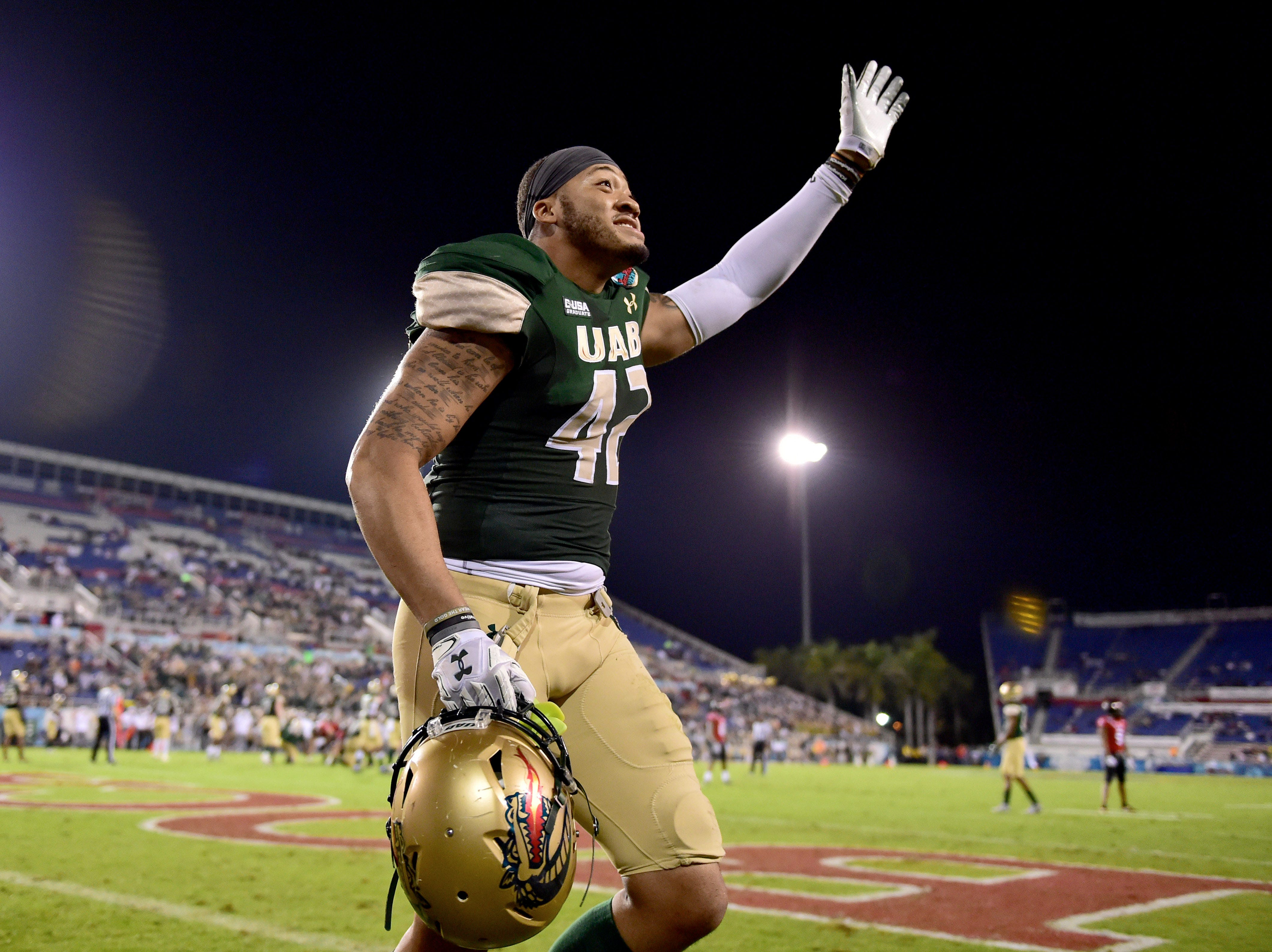 UAB Blazers linebacker Kylen Binn (42) waves after being disqualified during the second half against the Northern Illinois Huskies in the Boca Raton Bowl.