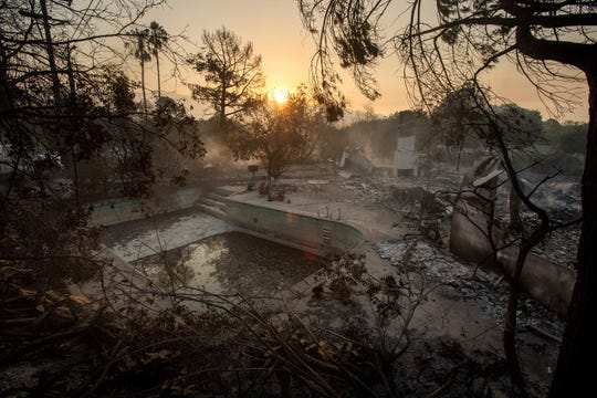 The sun rises behind a home leveled by the Holiday fire in Goleta ab1f3eb156