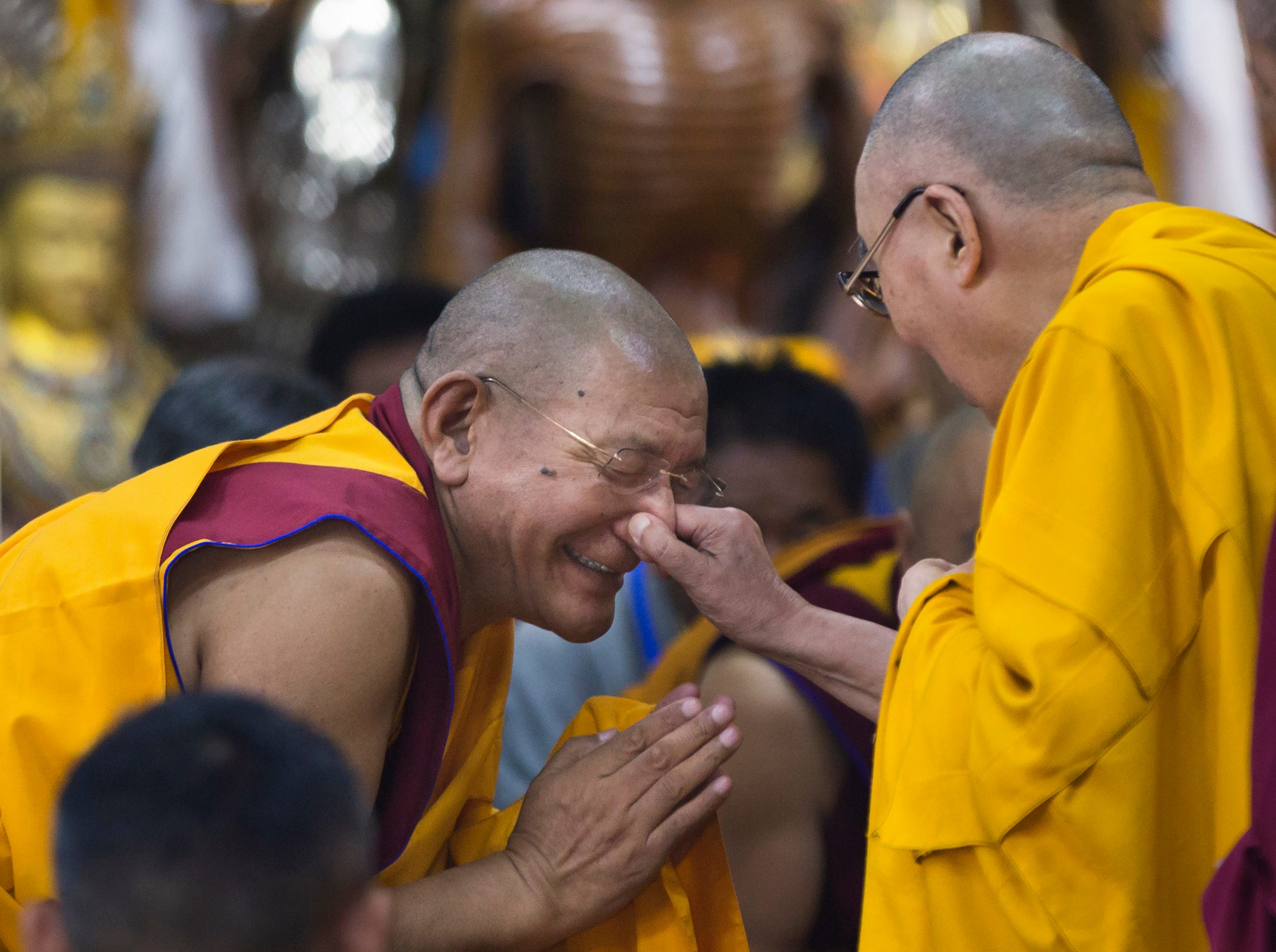 June 7, 2018: Tibetan spiritual leader the Dalai Lama playfully pinches the nose of a senior monk as he arrives to give a talk to Tibetan youth in Dharmsala, India. Every year the Tibetan leader speaks to young Tibetans to introduce them to Buddhist precepts.