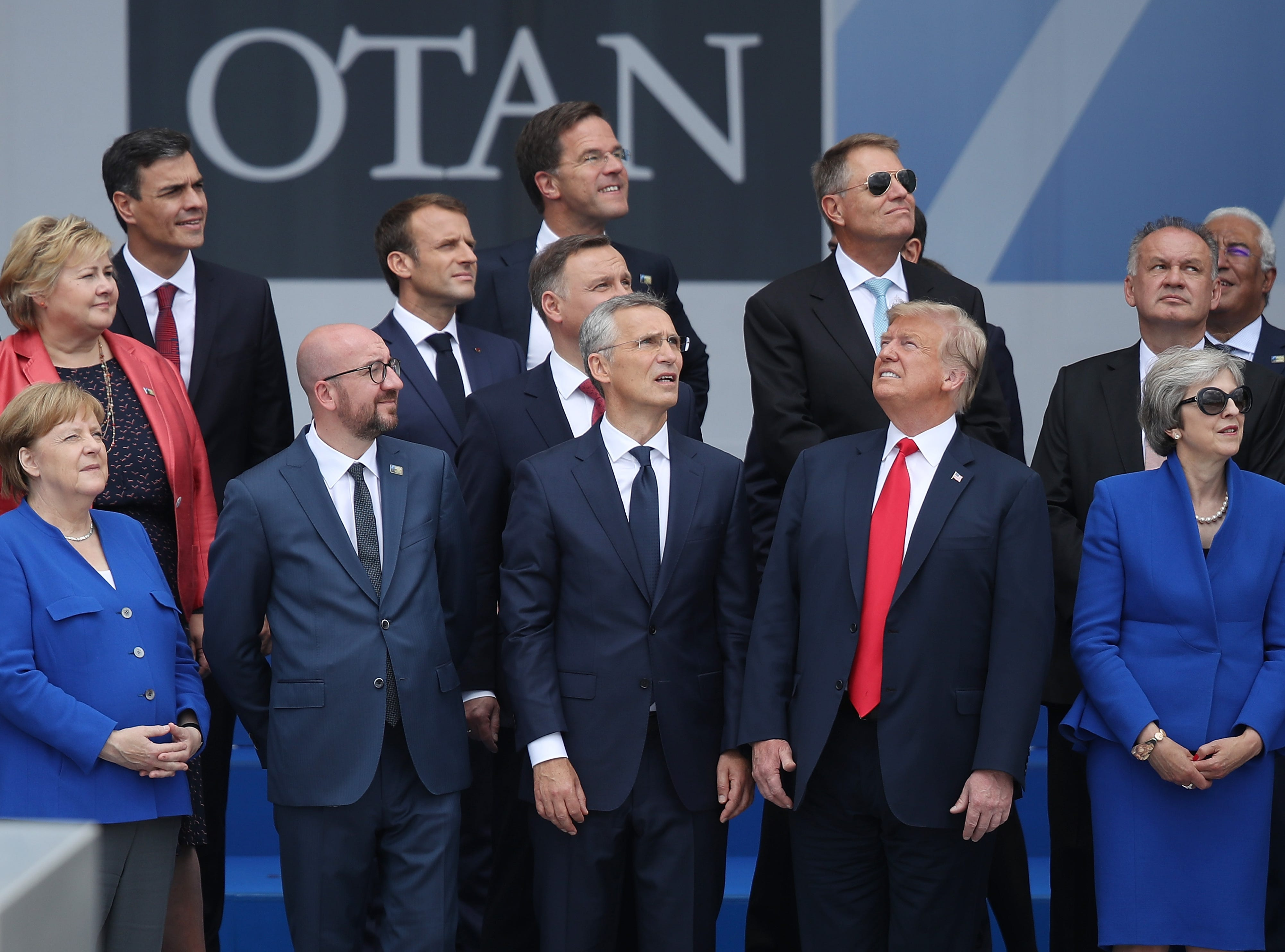July 11, 2018: (From L to R, first row) German Chancellor Angela Merkel, Belgian Prime Minister Charles Michel, NATO Secretary General Jens Stoltenberg, President Donald Trump and British Prime Minister Theresa May attend the opening ceremony at the 2018 NATO Summit at NATO headquarters in Brussels, Belgium. Leaders from NATO member and partner states are meeting for a two-day summit, which is being overshadowed by strong demands by President Trump for most NATO member countries to spend more on defense.