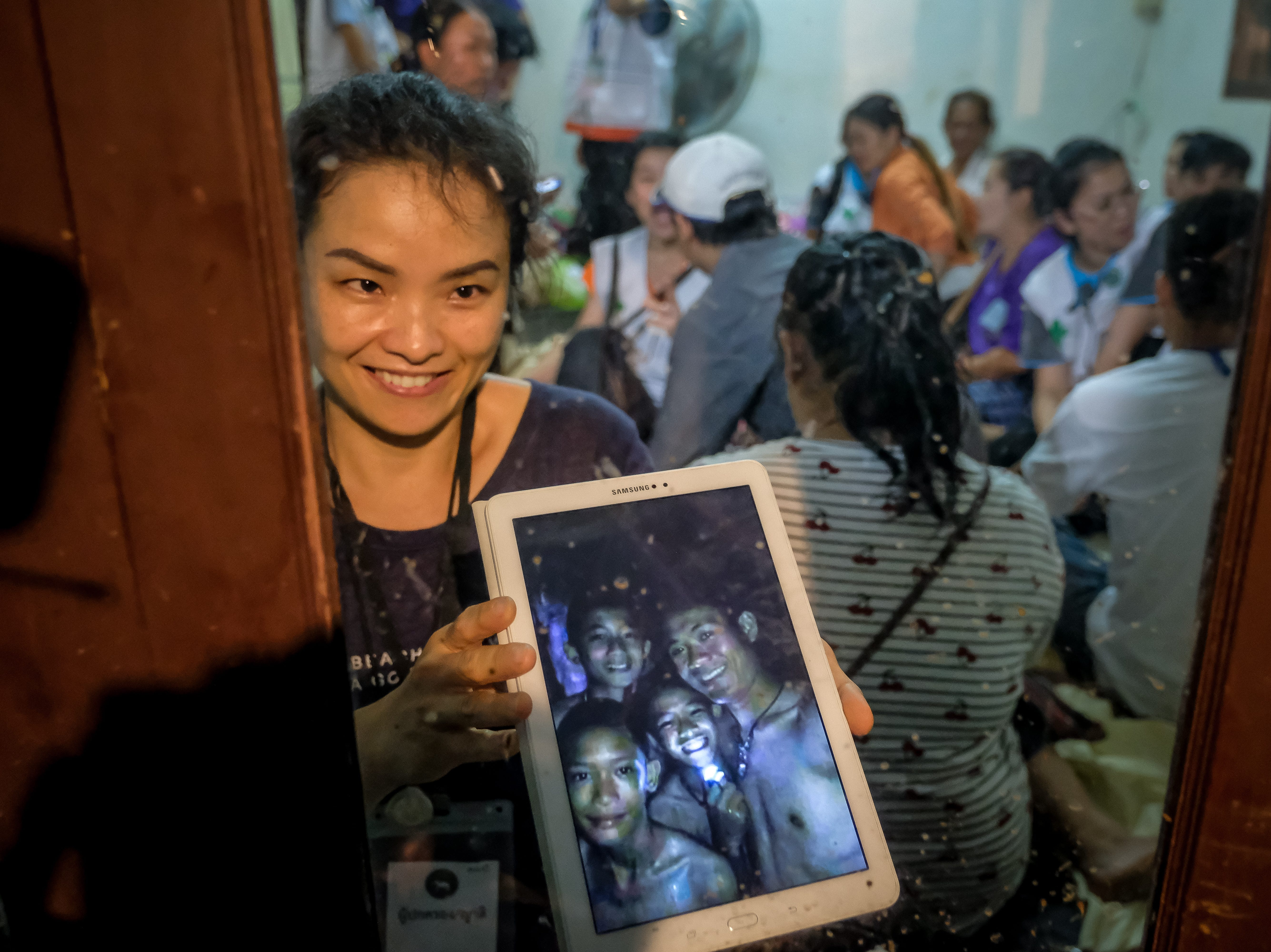July 2, 2018: Relatives show photos of some of the 12 boys and their soccer coach who were found alive in the cave where they've been missing for over a week after monsoon rains blocked the main entrance in Chiang Rai, Thailand. Chiang Rai governor Narongsak Osatanakorn had announced that the boys, aged 11 to 16, and their 25-year-old coach were being rescued from Tham Luang Nang Non cave after they were discovered by naval special forces and the challenge now will be to extract the party safely.