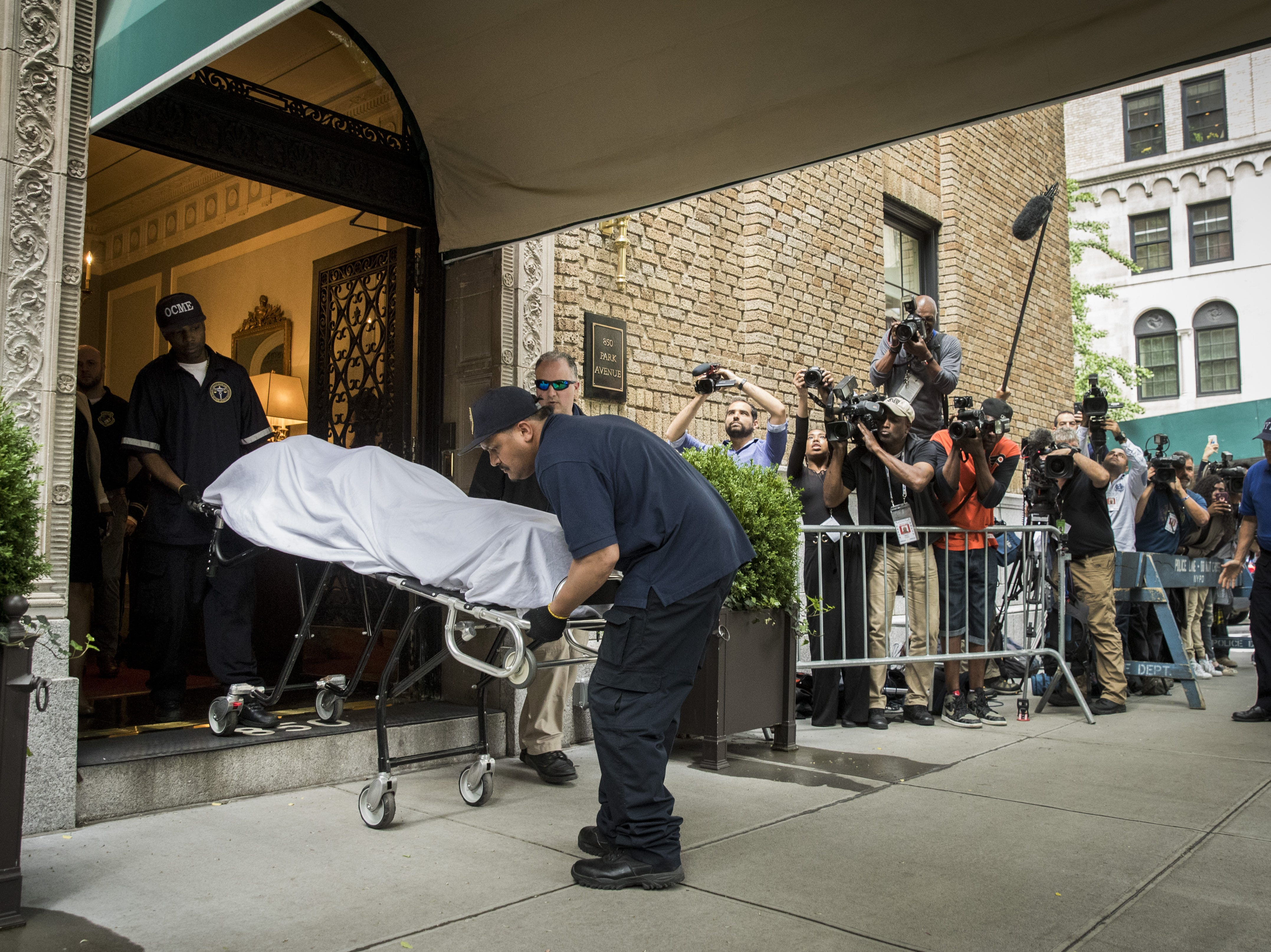 June 5, 2018: City workers carry the body of fashion designer Kate Spade out of her apartment building after she was found dead of an apparent suicide in New York City.