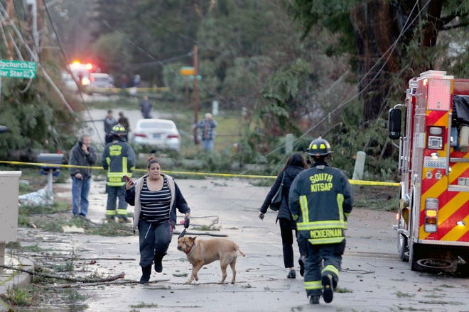 Residents and emergency personnel on Harris Road in Port Orchard, Wash., on Tuesday, Dec. 18, 2018, after a tornado touched down.