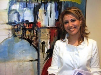 Fadia Afashe showing her work at an art gallery in Damascus, Syria. April, 2009.