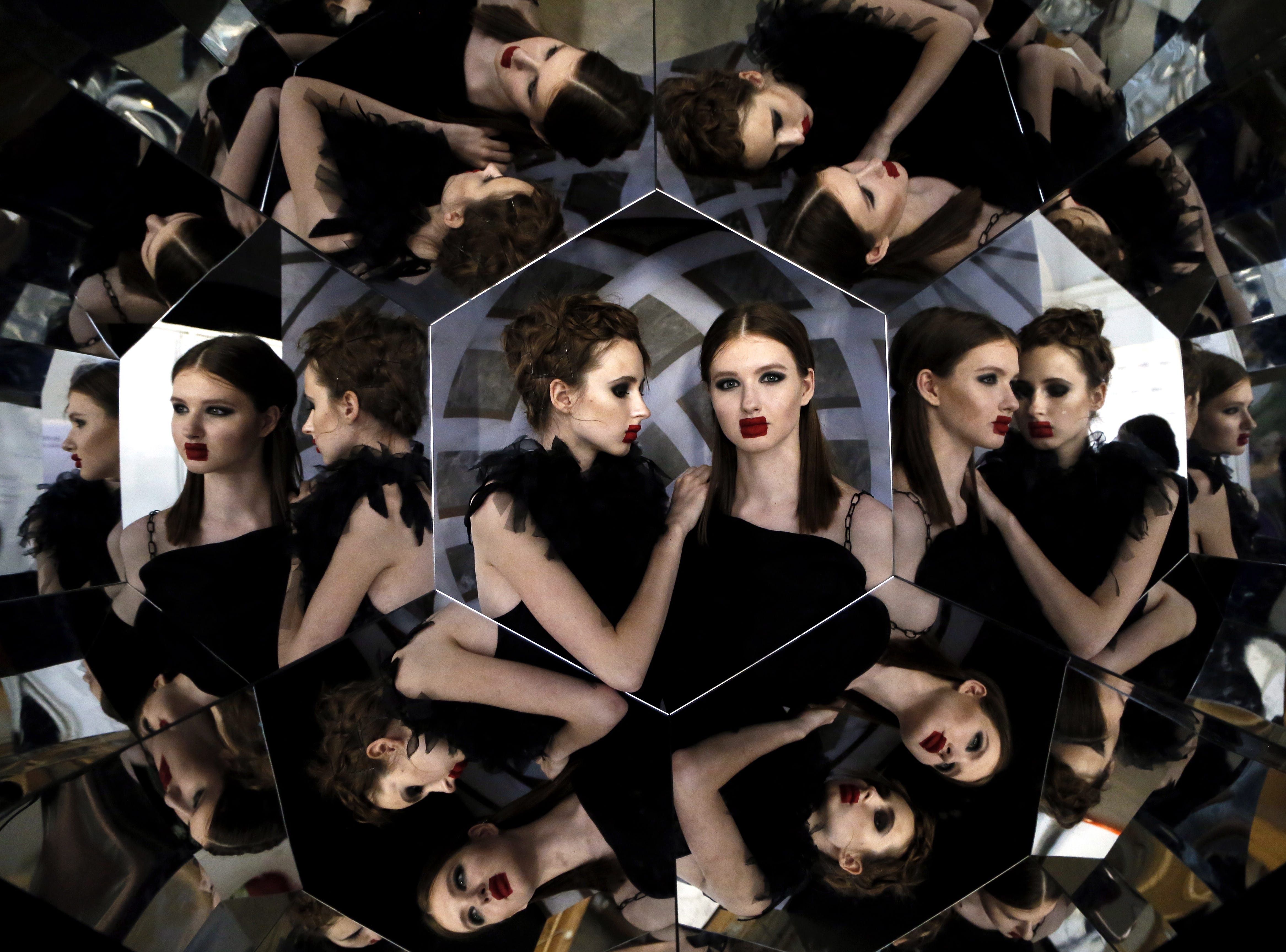 March 12, 2018: Models pose for a selfie in a mirror hexagon backstage during the Mercedes-Benz Fashion Week Russia in Moscow.