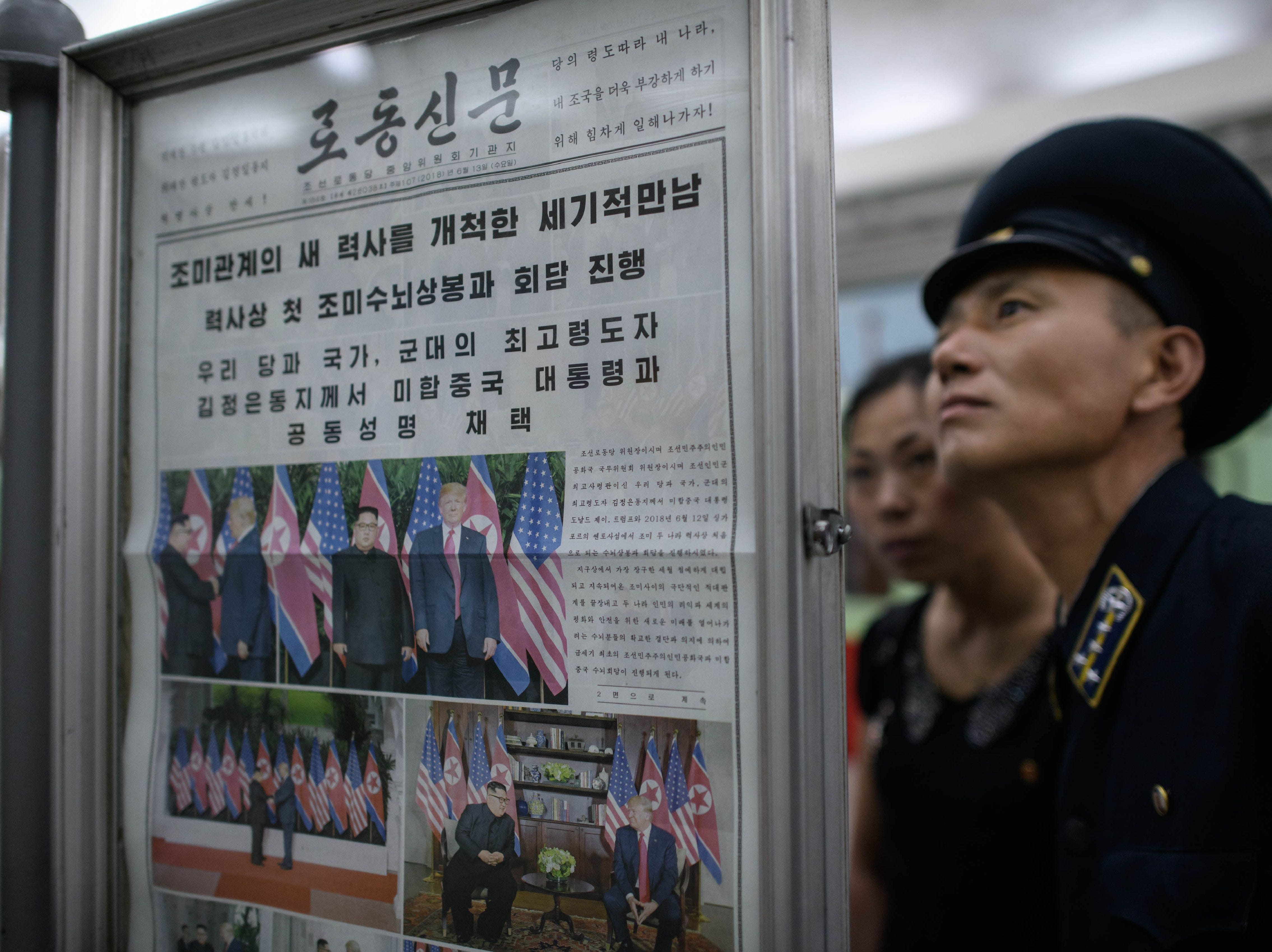 June 13, 2018: A conductor reads the latest edition of the Rodong Sinmun newspaper showing images of North Korean leader Kim Jong Un meeting with President Donald Trump during their summit in Singapore, at a news stand on a subway platform of the Pyongyang metro.