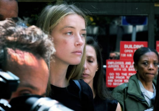 Amber Heard in May 2016 leaving Los Angeles Superior Court court after giving a sworn declaration that husband Johnny Depp threw her cellphone at her during a fight, striking her cheek and eye.