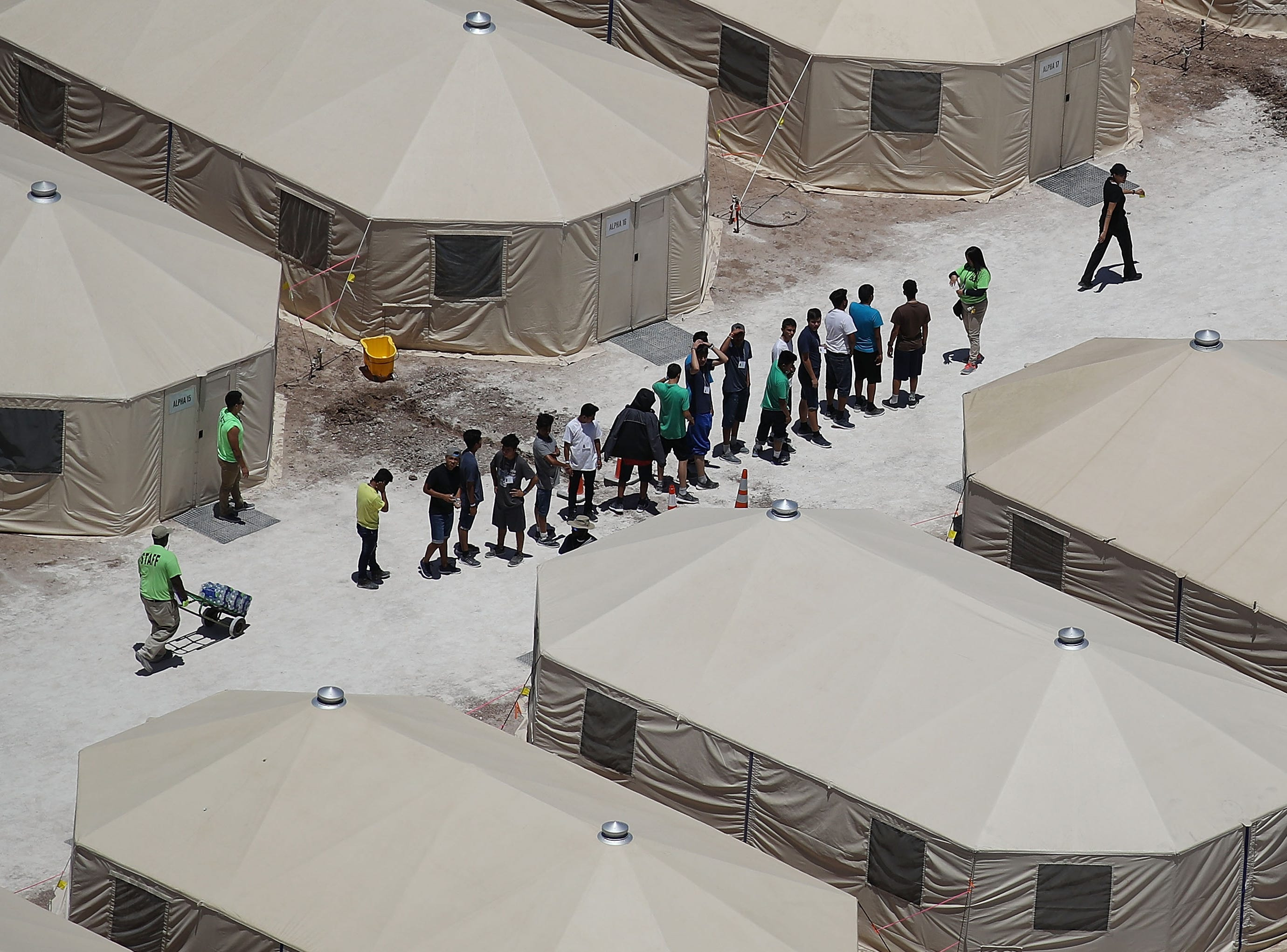 June 19, 2018: Children and workers are seen at a tent encampment recently built near the Tornillo Port of Entry in Tornillo, Texas. The Trump administration is using the Tornillo tent facility to house immigrant children separated from their parents after they were caught entering the U.S. under the administration's zero tolerance policy.