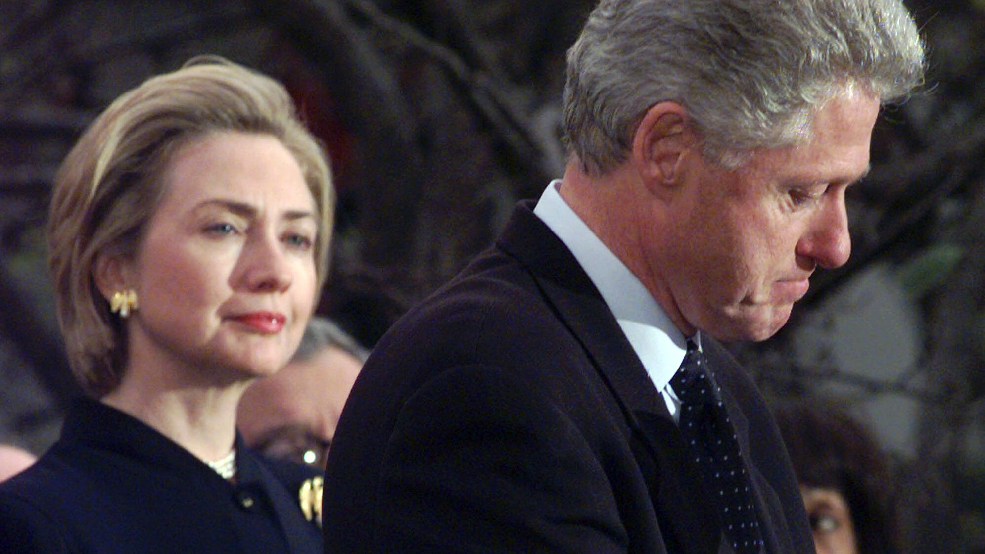 Former fist lady Hillary Rodham Clinton watches President Clinton pause as he thanks those Democratic members of the House of Representatives who voted against impeachment in this Dec. 19, 1998 file photo.