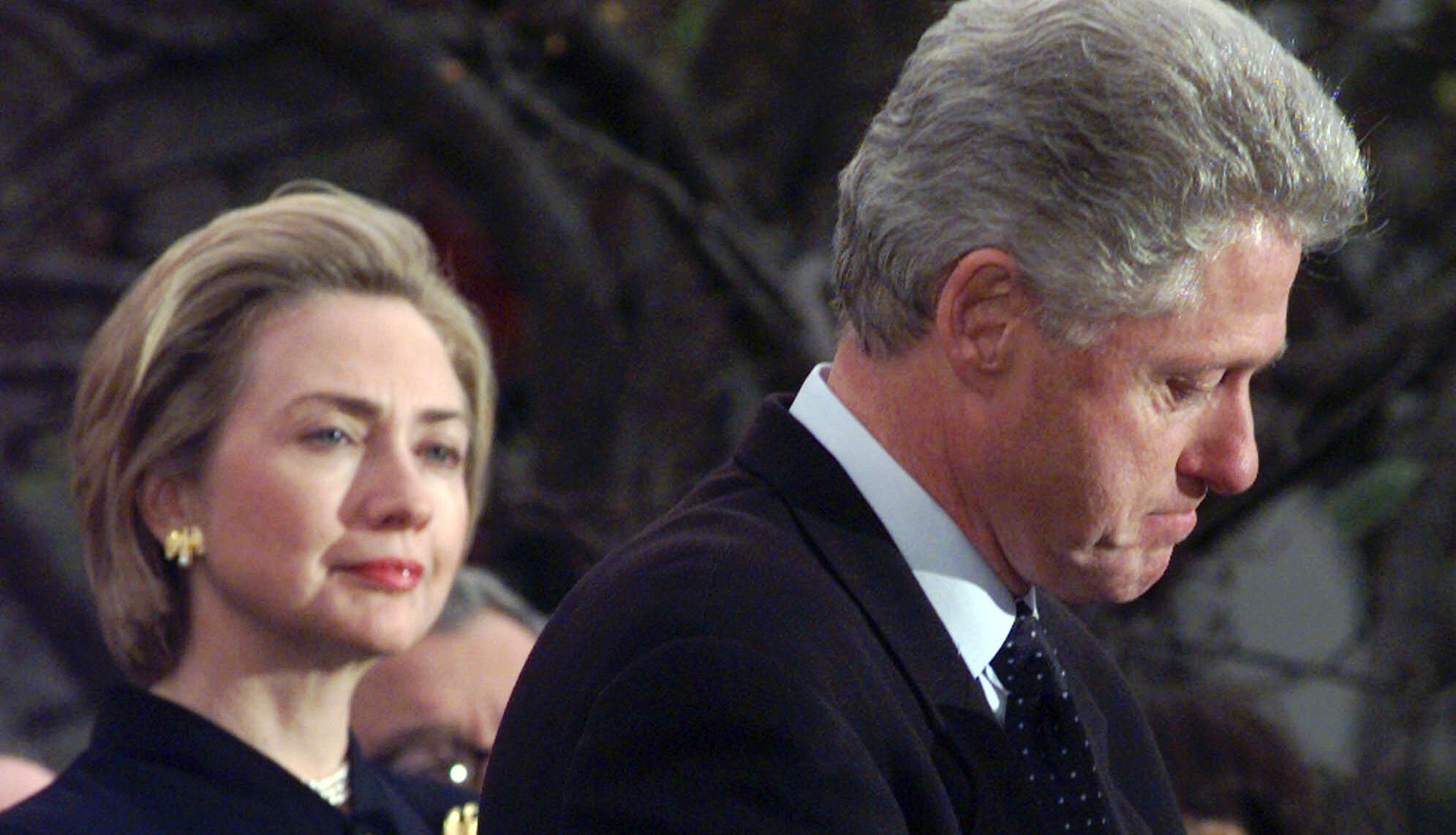 **FOR USE WITH AP LIFESTYLES**    ** FILE ** First lady Hillary Rodham Clinton watches President Clinton pause as he thanks those Democratic members of the House of Representatives who voted against impeachment in this Dec. 19, 1998 file photo. Many women weigh in on why political spouses stand by their men. (AP Photo/Susan Walsh, File) ORG XMIT: NYLS511