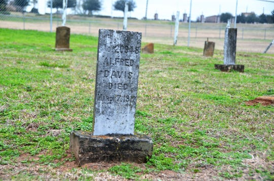 A tombstone marks the grave site of a state prisoner buried in the Old Imperial Farm Cemetery, which is about a half-mile from the site where the remains of 95 African Americans were found in Sugar Land, Texas.