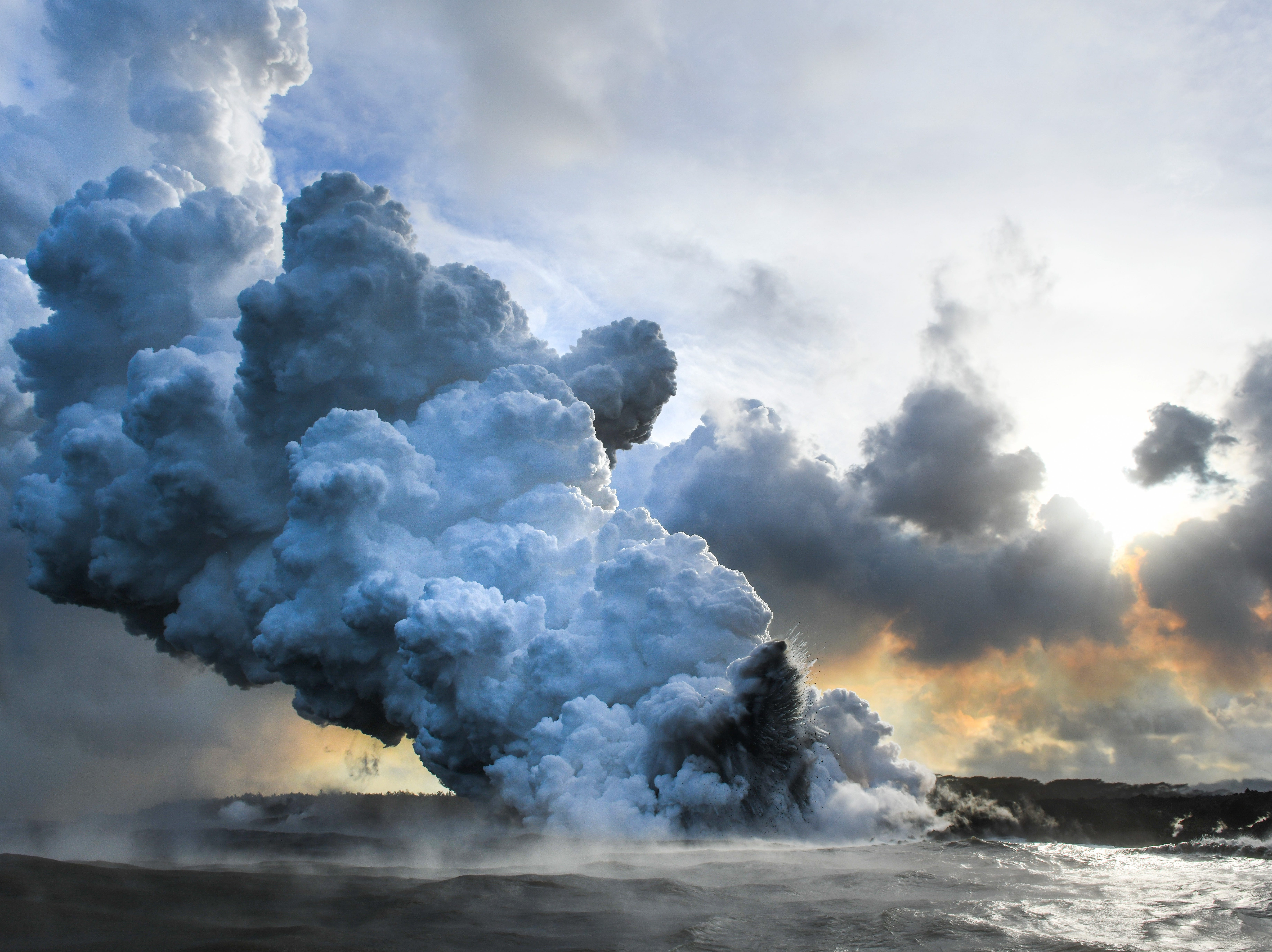 May 21, 2018: Steam rises from the entry point where lava from the Kilauea volcano hits the Pacific Ocean in Hilo, Hawaii. The Kilauea volcano erupted on May 3, with the lava flow destroying 24 homes and causing the evacuation of 2,000 people.