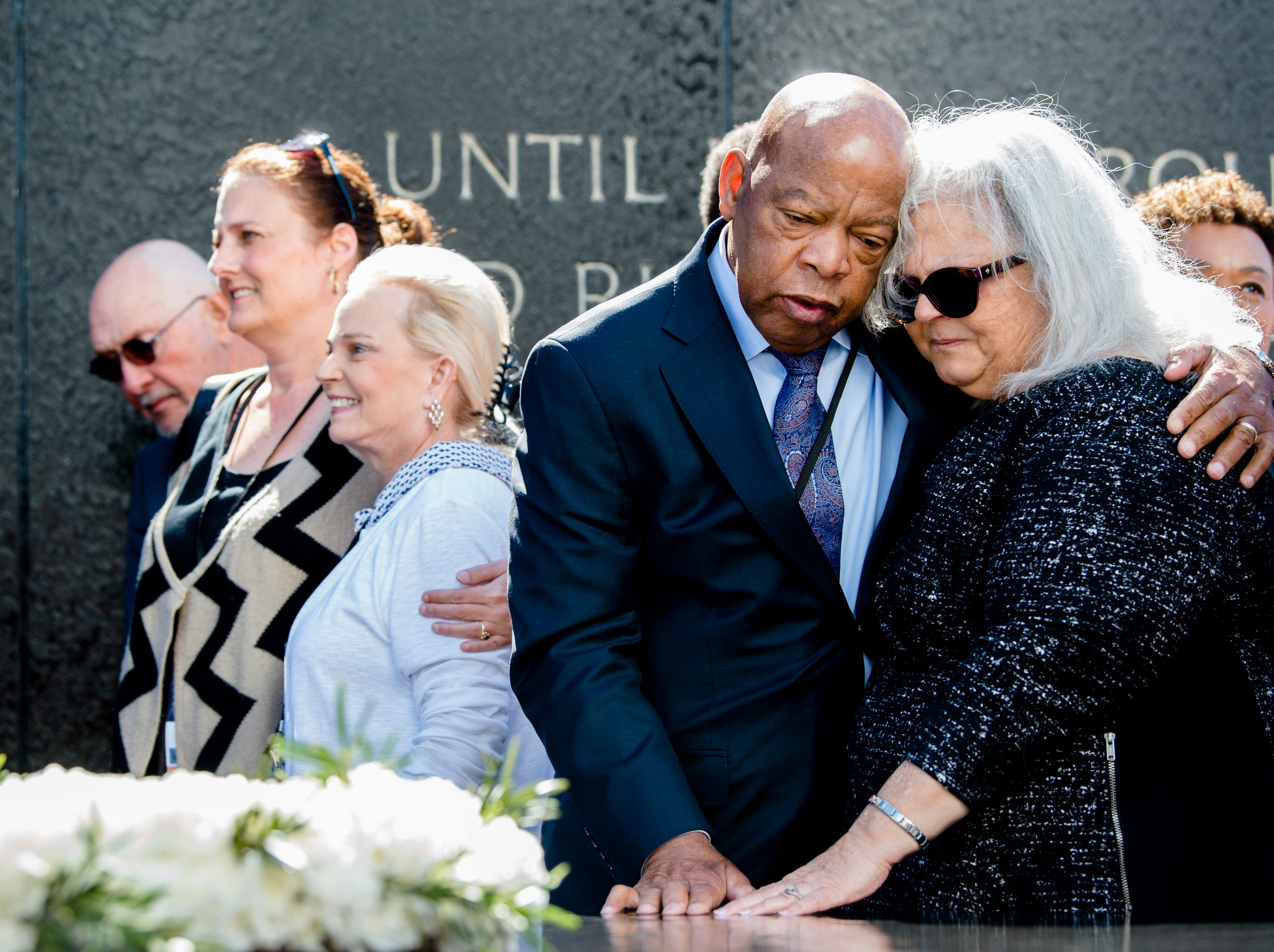 March 3, 2018: Congressman John Lewis embraces Susan Bro, mother of Heather Heyer, while touching the Civil Rights Memorial, during a wreath laying ceremony in Montgomery, Ala. Heather Heyer was killed in Charlottesville, Va., on Aug. 12, 2017, while protesting the Unite the Right rally.